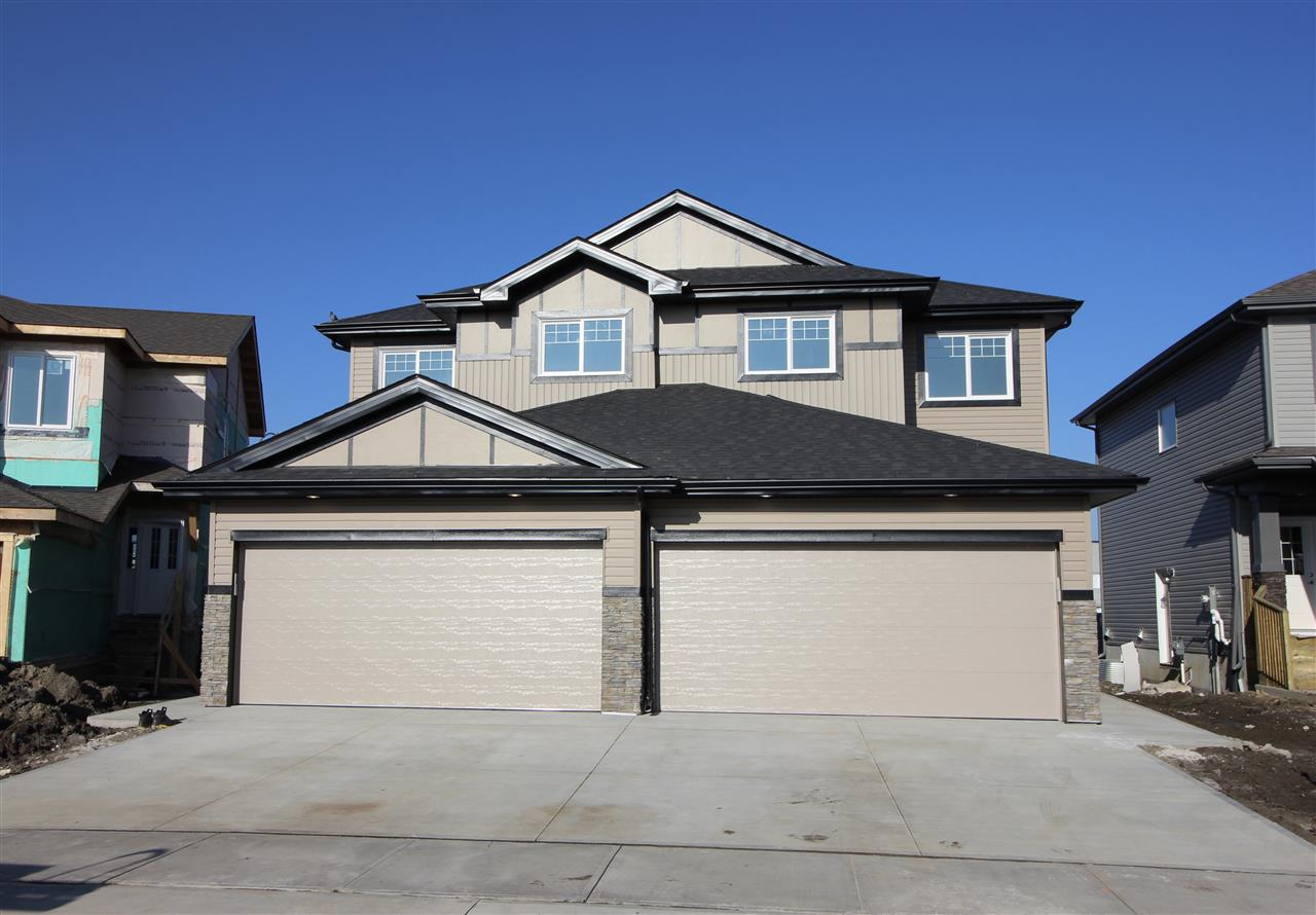 This brand new half duplex at almost 1500 sq ft on the upper two levels has been built with executive style! The open concept main floor features a u shaped kitchen with eating bar, abundance of white cabinetry that is full height, stainless steel top of the line appliances and walk through pantry to the mud room area with access to the garage. Living room and dining nook area are bright and spacious with a wall mount fireplace. Upstairs has a huge master suite with walk in closet and ensuite with a double shower and office space, laundry room, 2 other good size bedrooms and main bath complete this level. The basement has side entry access to the outside and is unspoiled to await your finishing touch! double attached garage.The yard is west facing to allow the enjoyment of full afternoon/evening sun.