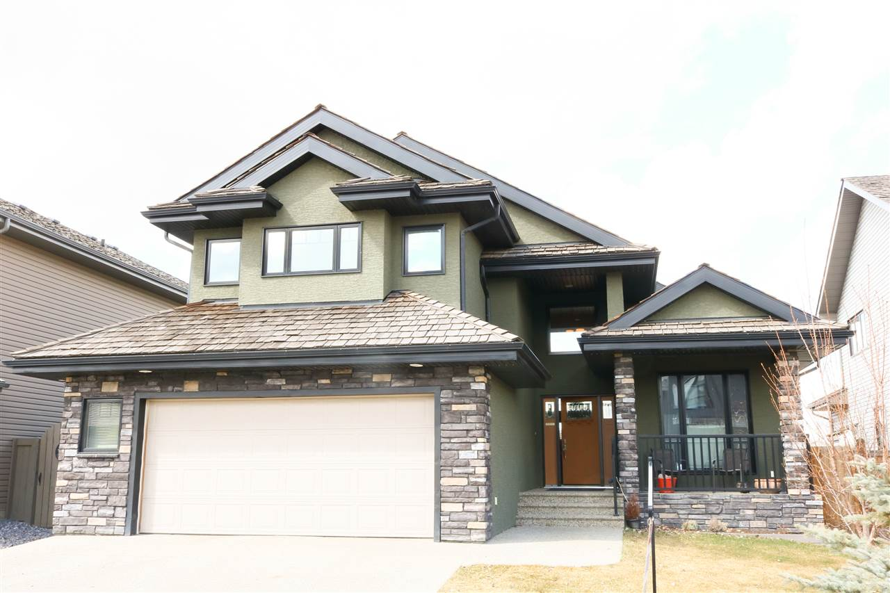 A newer Bungalow in the newer part of Wedgewood. This is a large bungalow 2075 sq. ft. as per RMS. above grade. Master suite plus a Den on the main floor. Total 4 Bedrooms plus Den. The master bedroom has a large walk-in closet and a full ensuite bath. There are 3 more bedrooms down. A large Bonus room above. Very open plan with Coffered Ceilings, Granite Counters, Pantry, Built-in China Cabinet, Wine Rack, SubZero Fridge, Viking Induction Stove... Walnut Hardwood and Ceramic tiles. The Basement is fully Finished with 2 Bedrooms, Huge Rec. room, Storage room, large windows and High Eff. Furnace & Tank. There is a Heated, Oversize Double Garage. Stucco & Stone Exterior, Covered front Porch, Rear Deck with Gas Line & Patio. Exposed Aggregate Driveway and Walk. Nicely landscaped with a variety of choice trees in the fenced yard. Mint condition, quality home that must be seen....