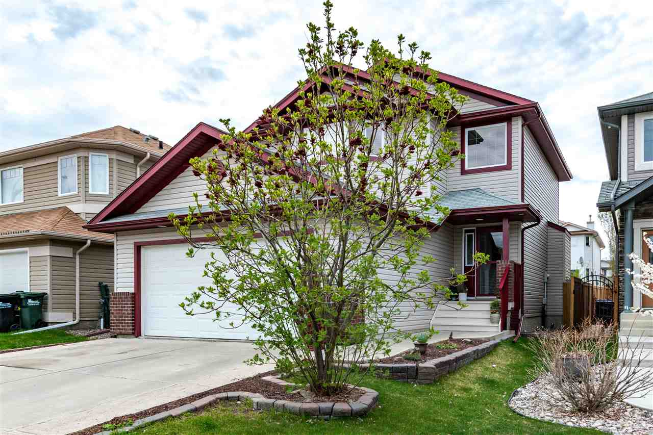 Located in family friendly Foxboro! Welcome to this 1475 SQ FT 2 storey home with a FULLY FINISHED BASEMENT! Super floor plan with a spacious entry way, hardwood flooring and living room with attractive gas fireplace. Open and bright kitchen with all appliances, pantry and a large dining area. Garden doors off kitchen lead to a private west facing backyard with a huge deck! 2 piece powder room on the main level. Upstairs are 3 bedrooms plus a 4 piece bathroom. The Master Bedroom has a walk-in closet and a 4 piece ensuite. The basement offers a large family room with laminate flooring, a 3 piece bathroom, and storage space. OVERSIZED DOUBLE ATTACHED GARAGE INSULATED & DRYWALLED. Nice curb appeal and close to parks, playgrounds and walking trails. AWESOME VALUE! Just move in and enjoy!
