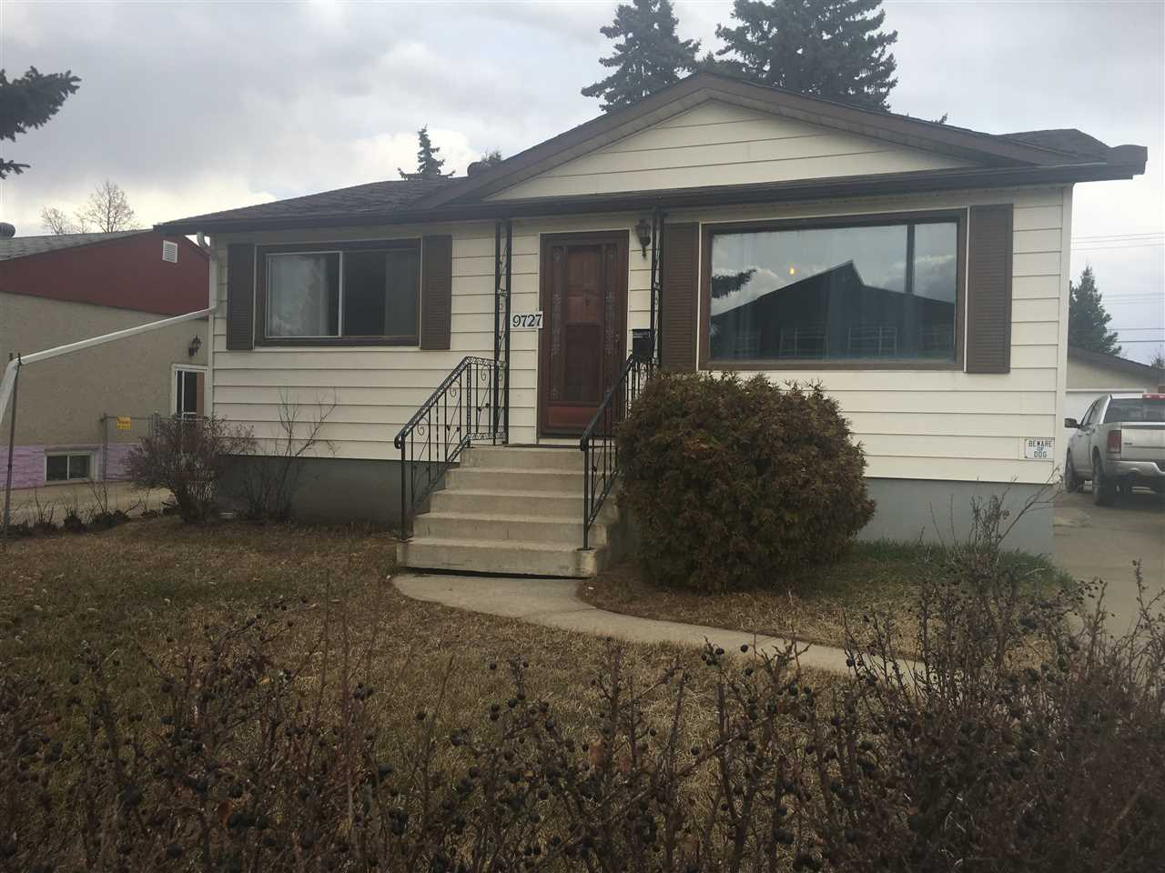 Perfect for the first time buyer or investor featuring a sub-dividable lot! Super solid bungalow with 4 bedrooms, 2 up 2 down. Kitchen features maple cabinets, and updated countertops. Living room has cove ceiling. New 100 amp electrical service and sump pump. Huge 50x165 lot enough room for 2 homes and still have a good sized yard! There is a storage shed, dog run, dog house, RV parking, front street access, lane access, fruit trees, mature trees, patio and side driveway. Oversized contractor garage with 220V wiring. Lighting over the workshop countertop and cabinets. Separate entrance has suite potential for up/down rental. Quick possession available, walk to all levels of schools including Jasper Place High and St. Francis. Short walk to indoor swimming and skating. Excellent public transportation.