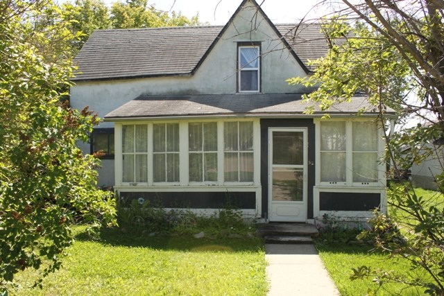 This 1920 built 1.5 story home is located on a 50'x140' lot, less than a block from main street in the prairie community of Tofield.  Walking distance from schools, playgrounds, parks, fairgrounds, arena, and more.  Flat site for building!  Lot zoning is R-1, meaning a duplex could be a future feature of this excellent location.  Sold primarily for lot value.