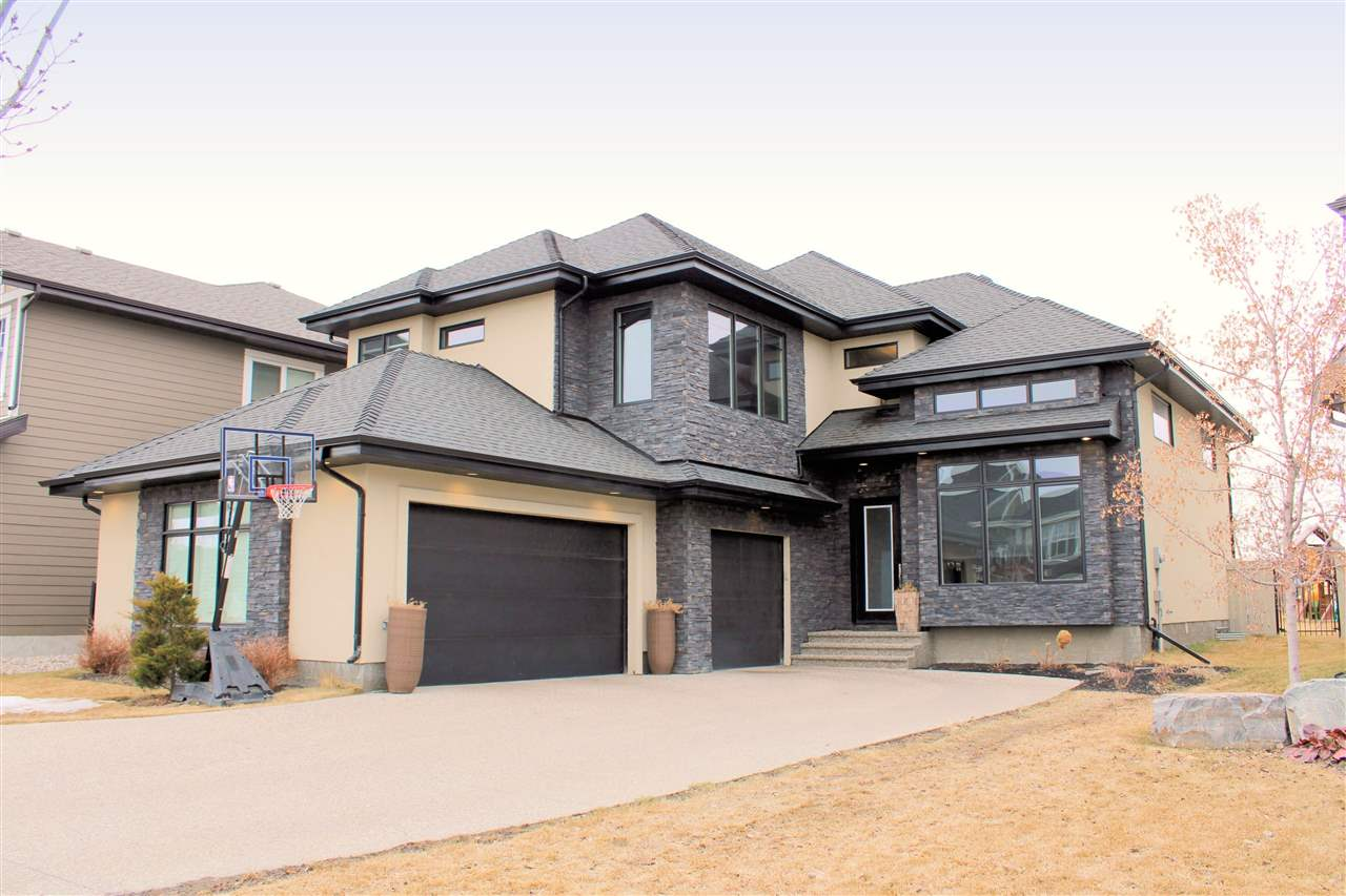 Stunning, stylish and sophisticated, this custom built 2 storey in prestigious Cameron Ravine Landing is like a dream home you can afford. Luxury touches abound in this 2,983 sq ft, 3 bedroom home, starting from the moment you walk in. The soaring ceiling over the living and dining areas combined with the huge windows provide a bright and airy welcome.. The gourmet kitchen features a large island with granite and 6 burner gas stove, plenty of dark cabinetry, stainless appliances, a built-in espresso/coffee machine, pantry and spacious nook. The main floor also features a flex room that can serve as a 4th bedroom. Luxury finishes include ceiling-height doors and rich hardwood floors. The upper level boasts a cozy bonus room, 2 bedrooms and a HUGE master with walk-in closet and spa-like ensuite with heated floors, steam shower and his and her sinks. The fully landscaped and private yard is an ideal place to play and BBQ and backs a walking trail. The homes in the Landing are nothing short of outstanding.