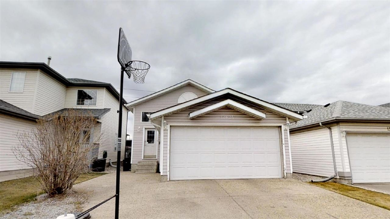 Welcome to this bright open concept bi-level in the family friendly community of Cumberland in Edmonton?s NW. This house has a double attached garage and a big bright entrance as you enter. Upstairs you?ll find an open concept kitchen and dining room. The kitchen is huge, bright and has lots of cabinets and a very big kitchen island that can be used as an eat up bar. Bedrooms 2 and 3 are upstairs and of a generous size. The basement is professionally finished with large windows a huge storage closet, ample living space and master bedroom with the 4 pc ensuite. The yard is fully fenced with a gate to the greenbelt and off leash area in the back that connects with many trails. This house is well taken of,has a newer HWT, newer shingles and a new bluetooth operated garage door. Walking distance to all amenities, bus routes and just minutes to the Anthony Henday orbital HWY
