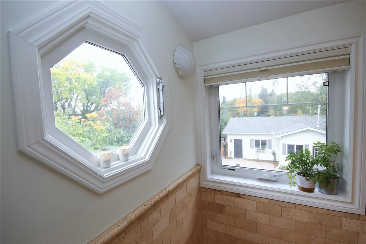 Unique windows overlook your rear yard.