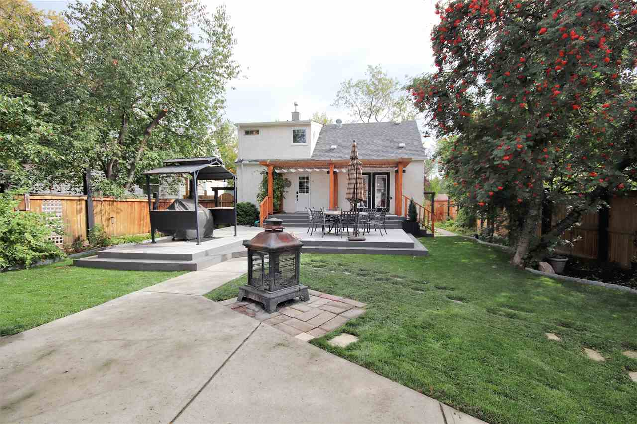 Lots of mature trees and landscaping.  The corner water fountain, firepit and barbeque area are included in the sale.