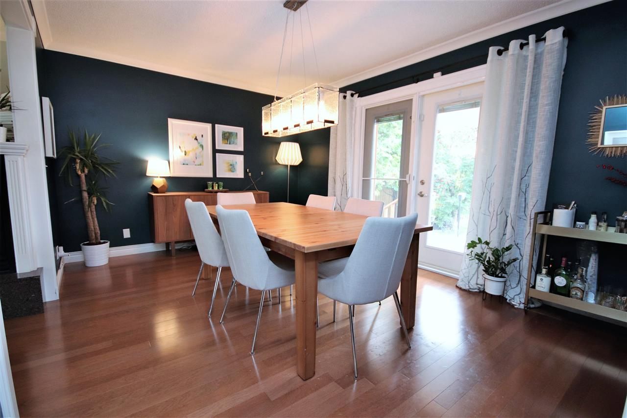 The Brazilian hardwood extends into the spacious formal dining room.  Painted in bold colors and illuminated with a modern light fixture, this room can comfortably seat a table of eight.