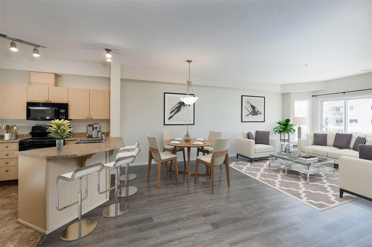 Attention investors, first time home buyers and students! This two bedroom two bathroom condo is ready for you! Location is absolutely stunning. Within walking distance you can find: LRT station, Clareview Recreation Centre, grocery stores, restaurants and other necessary amenities. New paint and new flooring gives this 1,102 sqft condo a fresh modern feel. Its open concept provides a spacious living room with 9 foot ceilings throughout. Kitchen has plenty of cabinets and counter space with a well designed eat-up bar. Natural light pours into the unit through the south facing patio doors and balcony.  A large master bedroom has a walk-through closet and a private 3-piece ensuite. Also featured is a second 4-piece bathroom, en-suite laundry with tons of storage. Complex has its own social room, gym and bookable party room. One assigned underground parking stall is also included .