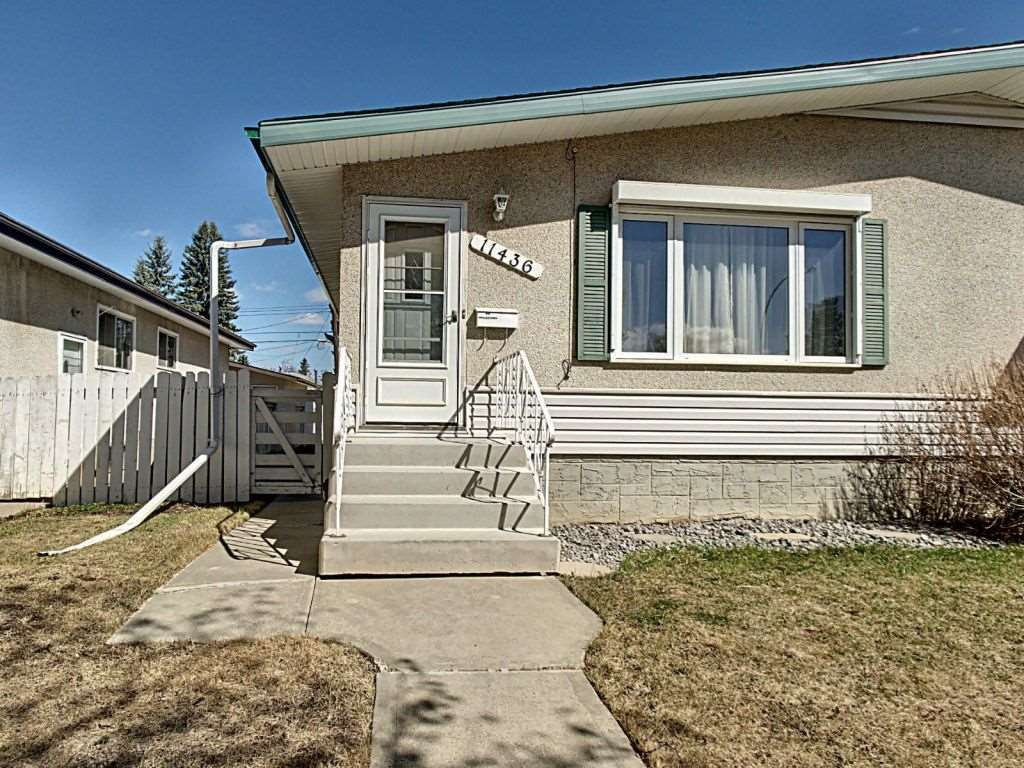 SELLER MOTIVATED. Don't miss this Half Duplex Bungalow! Located in one of Edmonton's most sought-after neighborhoods, Royal Gardens.This is a dream location as it is walking distance to grocery stores, restaurants, schools, churches, medical offices and public transportation! This very well-maintained, upgraded home has 3 good-sized bedrooms on the main floor with a full bath.In addition, a bright spacious living room and kitchen complete with updated flooring, paint, cabinets and counters.The lower level has a huge rumpus room, a VERY large back bedroom with a partial wall which could easily turn this into two good sized bedrooms. The full bathroom, laundry and ample storage complete this level.No condo fees. Parking for 2 vehicles on gravel, with access from alley.