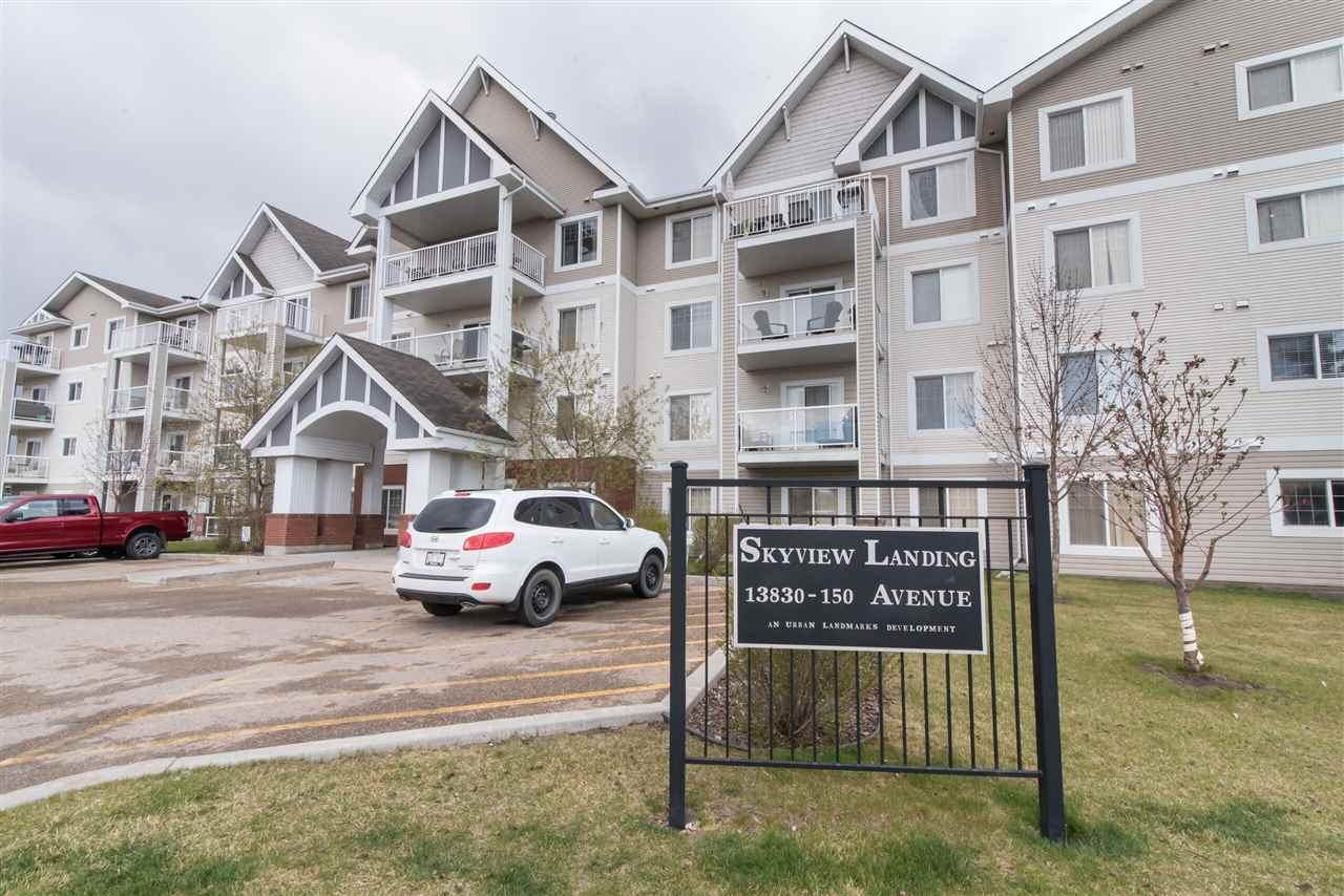 Looking for a newer condo with 2 PARKING STALLS? You'll love this move in ready home! Enjoy those summer evenings looking at the tree lined street on your fully enclosed & covered balcony that includes a gasline for your BBQ'ing pleasure! This open concept unit has the kitchen and living room (with built in swag light) separating the 2 good sized bedrooms. The kitchen has ample cabinets and a newer stainless steel fridge. The master suite has a walk through closet that leads to your 3 pce ensuite with an oversized shower. There's also another full bath that includes a tub. Good storage space in the laundry room off the kitchen. This building is professionally managed & includes an exercise room & lounge area. The condo fees include; heat, water & gas. Located close to schools, public transit & shopping. A great condo for first time buyers or empty nesters!