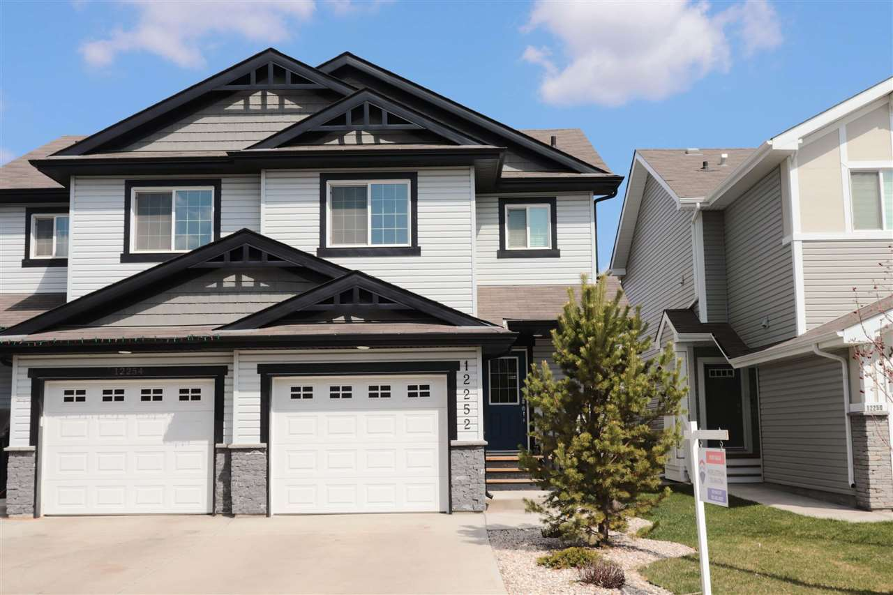 TRANQUIL SETTING in Rapperswill! This beautiful half duplex features modern d�cor, open concept living and NO CONDO FEES! With 1,270 sq.ft of living space, plus a PROFESSIONALLY FULLY FINISHED BASEMENT, 3 bedrooms, 2-4pc bathrooms & 2-2pc bathrooms, there's plenty of space for everyone! The open concept living room/dining area and kitchen featuring sleek Espresso cabinets, stainless steel appliances, decorative tile backsplash, corner pantry, island w/ breakfast bar has wonderful functionality. Patio doors lead out onto your private two-tiered deck and fenced yard which backs onto a treed greenspace and walkway! Upstairs is the Master suite with large closet and 4pc ensuite and two additional bedrooms as well as a 4pc bathroom. The professionally finished basement is where you'll find a large rec room, 2 pc bath and laundry/utility room. Located close to all amenities and to the Henday. Great family home!
