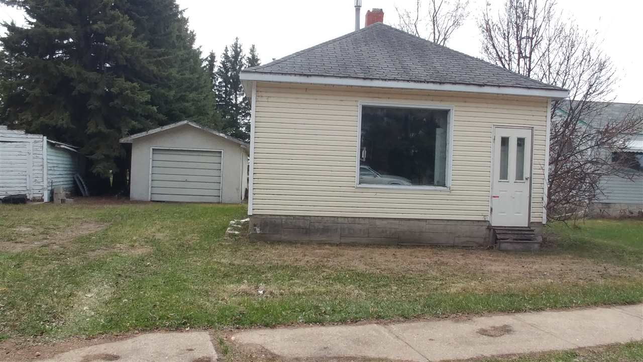 """Large lot 9.81 Sq M in Andrew. Garage is in good condition. House may have to be demolished. Sold """"As is where is""""."""