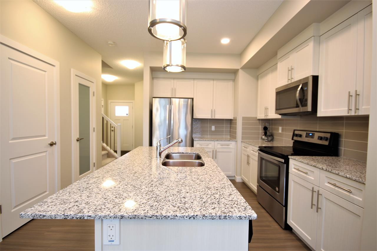 No Condo Fees in this Dolce Vita Picasso II!  Why wait to build, wait for landscaping, wait for window coverings?  This beautiful home feels like brand new & is ready for you!  Located in ONE at Keswick, this 2 storey end unit boasts a modern, open feel & finish. 9 ft ceilings on the main. Lovely light kitchen w/ quartz counters, undermount sink, Whirlpool stainless appliances, separate pantry & contemporary lighting. Light grey, vinyl plank floors extend through the kitchen to the open & spacious dining room & living room.  2 pce powder rm on main.  3 spacious bedrooms up incl. a king sized master suite boasting a great, walk-in closet & 3pce ensuite w/ oversized shower. 4 pce main bath w/tile floors & one piece tub/shower w/ tile accents. Unspoiled basement has rough-in plumbing & space for a potential 4th bdrm & rec room. A garden door opens to a sizable yard w/ sod & rear fence complete.  Oversized single attached garage. Located in desirable SW Edmonton, minutes to shopping & all amenities!
