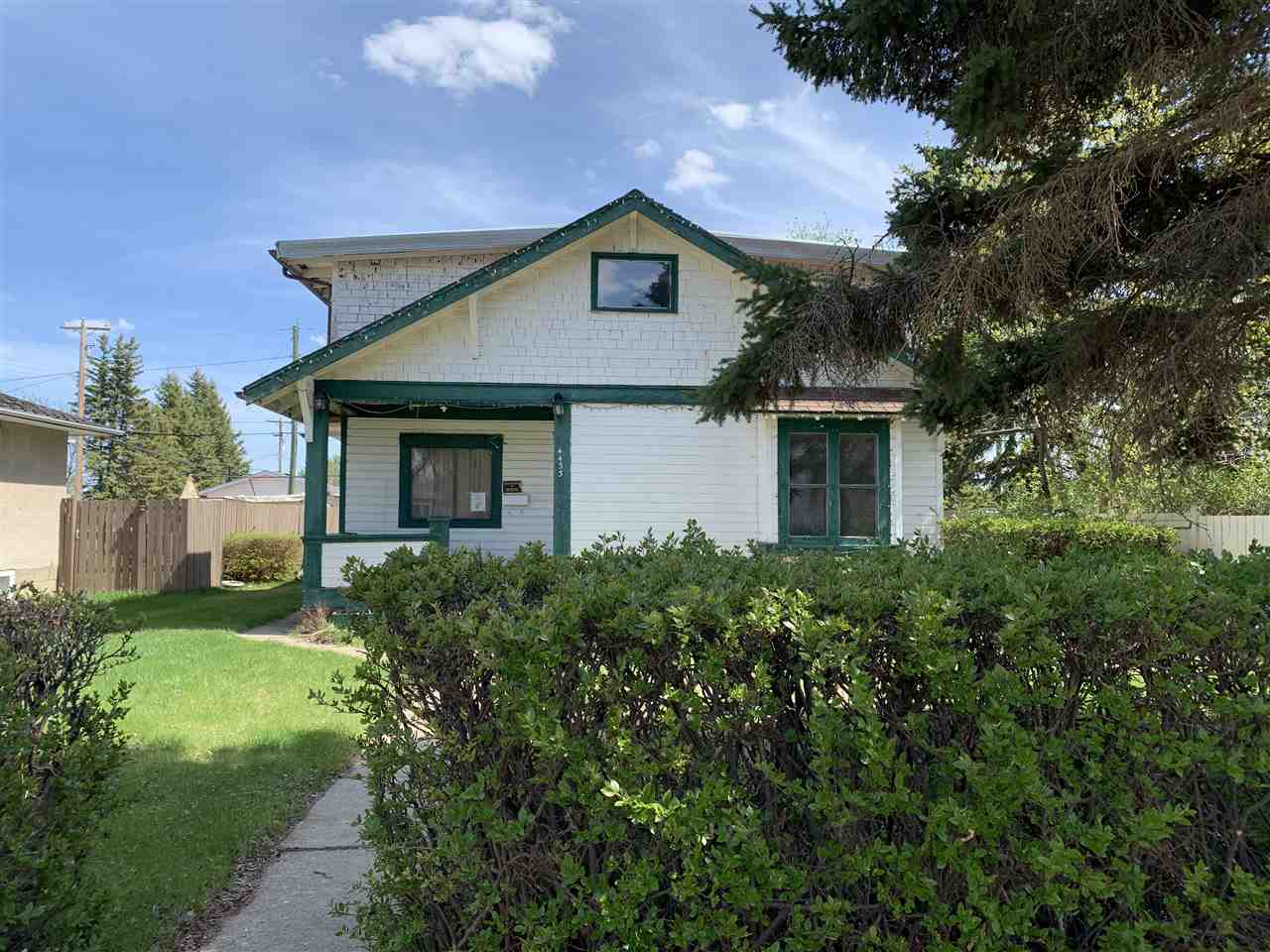 Welcome to Vegreville! This cute story and half is mostly original and features a spiral staircase, a large kitchen and main floor laundry. Loaded with character, 4 bedrooms, and a huge lot this home has tons of potential! Property does need a significant amount of work and is being SOLD AS IS!