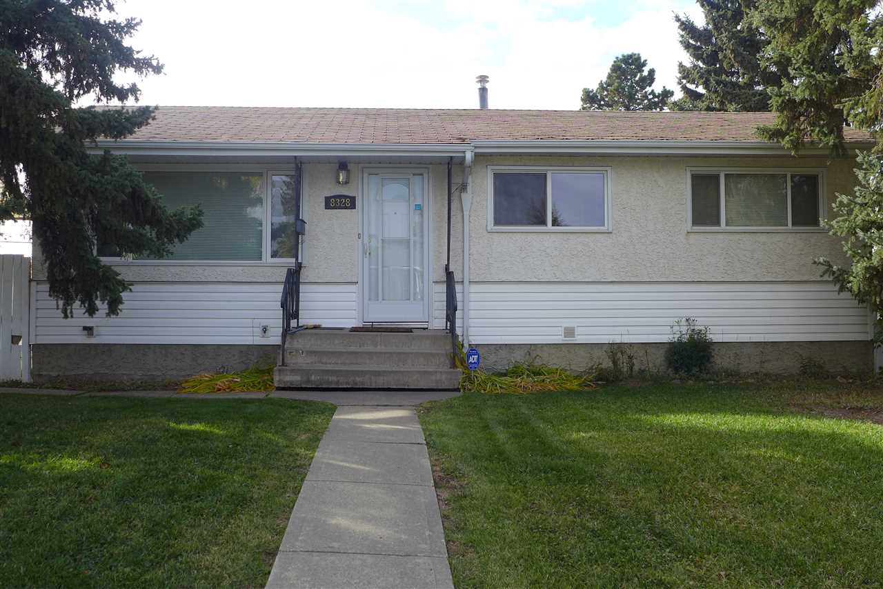 A SUPERB UPGRADED FAMILY HOME. This 5 bedroom 2 bath home has numerous upgrades such as: open floor plan, new windows; interior & exterior doors; kitchen; main bath upgraded; basement bath added; attic insulation added; suspended ceiling downstairs; large deck ; backflow valve; alarm; central vacuum; CENTRAL AIR CONDITIONING, original hardwood refinished and the list goes on. There is a garden for those that want to grow their veggies & a plum tree. There is a large 22 ft x 24 ft garage for the guys. This home is located  a block from the Misericordia Hospital and West Edmonton Mall and close to all schools elementary to high school. This home is a must see.