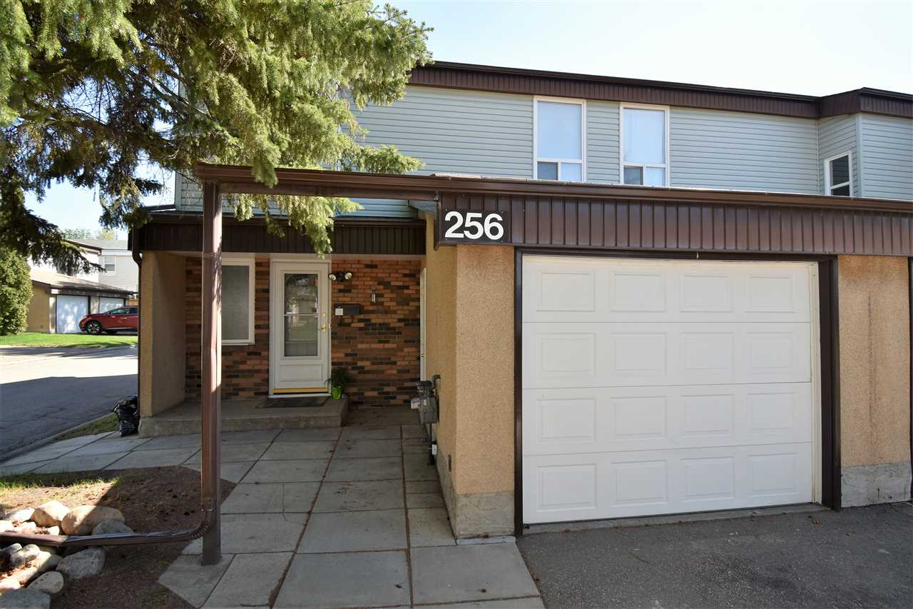 There are so many NEW or UPGRADED components & features in this 2-St END UNIT Townhome that make this a Rare opportunity. This Pet & Smoke Free 3 Bdrm-2 Bath home features new Laminate & Lino throughout and has a newer HWT & Hi-Eff Furnace, Elec Air Cleaner + Central A/C!! The Galley Style Kitchen offers a generous amount of NEW CABINETRY & counter space. The Bright & Cheery Great Room/Dining Room overlook the Fenced backyard with small garden and PARK GREENSPACE in behind!! Upstairs you will find a functional floor consisting of 3 Spacious Bedrooms w/ Laminate Flooring & a Renovated 4 Piece Bath. Need more space? The FULLY DEVELOPED BASEMENT has a Laundry Room, Storage Room & Family Room/Den!! Need Storage? The home has lots but the garage also has built in shelving & mezzanine storage!! Owner also installing brand new SS Stove & FrontLoad White W/D. Tons of parking with a Single Garage, 2 Driveway Stalls & 2 Visitor Parking Stalls beside the home. Quiet complex that is close to Transit, Parks & Schools!