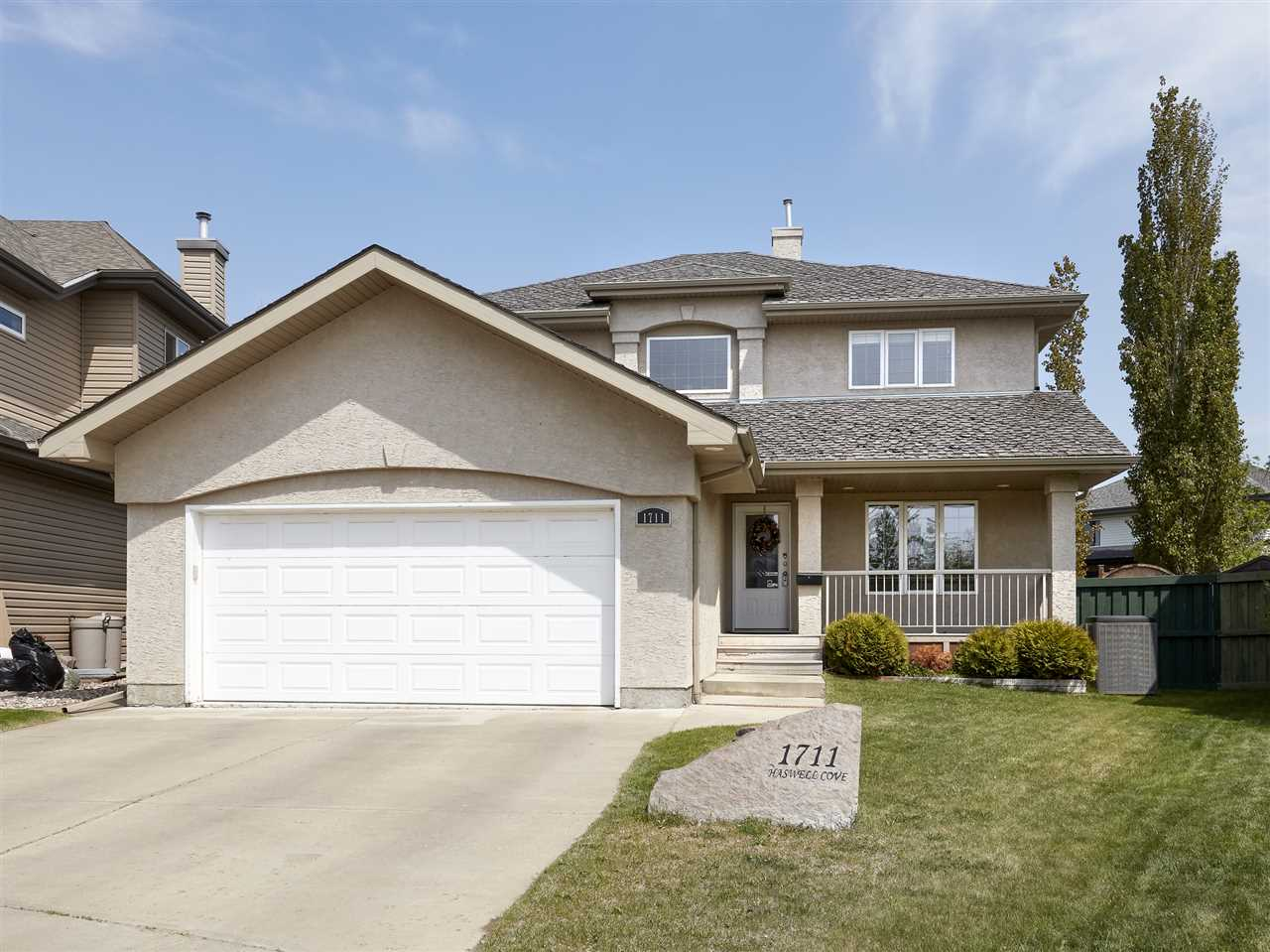 Former BIRKHOLZ Showhome located on a quiet cul-de-sac by a park in Haddow, beautiful finishings throughout. This stunning 2 story home has 2204sqft plus a finished basement totaling over 3379sqft of finished living space ? 4 bedrooms plus den/office, 4 baths - all located on a large pie-shaped lot (7384sqft) & more!  Entering the home you will love the vaulted foyer with a sweeping staircase. Step into the stunning kitchen with upgraded cabinetry & granite counter-tops. Open to the kitchen is the dining area & living room with gas fireplace. The formal dining room, 3 piece bath & boot room complete the main floor. Upstairs the master suite includes a 5 piece ensuite! Beds #2 & #3 are both a good size & a 4 piece bath completes the upper level. Downstairs is finished with a large family room, den/office, 3 piece bath & storage room! Outside enjoy the park like backyard that includes an outdoor sauna that you can use all year round. Incredible upgrades throughout, everything you are looking for in a home!
