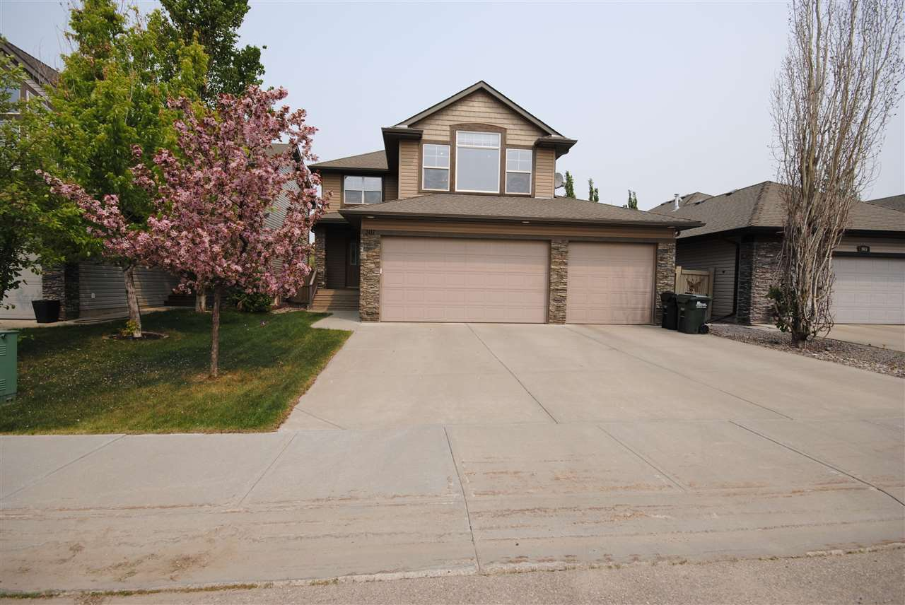 Have a look at this Ironwood home located in the Ridge. One of the few homes in Sherwood Park with a heated triple car garage including a drive through bay and hot/cold taps. Inside you'll find a spacious front entrance, open concept with living room boasting a stone feature wall and gas fireplace. The kitchen offers a breakfast nook and all stainless steal appliances. The upstairs has all new carpet & shows a large bonus room with a vaulted ceiling, 4 pc bath, 3 bedrooms including the master with an amazing ensuite featuring a multi-head, walk in shower (All new tile). The basement has plenty of room for whatever you'd like. This home offers many extras including a/c, hard wood and tile flooring. Come have a look for yourself!