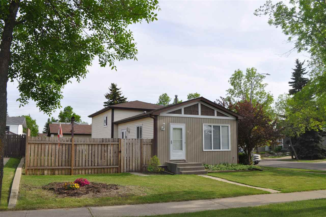 """Located in the quiet neighborhood of Deer Ridge St. Albert is a well-loved home. This classic split-level house offers pride of ownership and no """"just need to do's""""! The living area above grade is 1003 sqft and the 2 below grade levels offer another 946 sqft. It includes a 21x23 sqft double detached garage that can house two vehicles plus a work & tool area. As you enter the main floor you are greeted with new hardwood floors, kitchen with a breakfast nook, a dining room and an open-concept living room. Access to the backyard deck, huge private yard and the garage are off of the breakfast nook. The second floor is 533 sqft and features a 4 pc. bathroom that also serves as an ensuite by a 2nd door to the master bedroom and 2 spare bedrms. The 3rd level has a freshly renovated family room with new engineered hardwood and a 3 pc bathroom. The 4th level offers a large laundry room and much needed storage space. Here are the upgrades: windows, furnace, HWT, fresh paint, newly renovated 3rd level and hardwood!"""