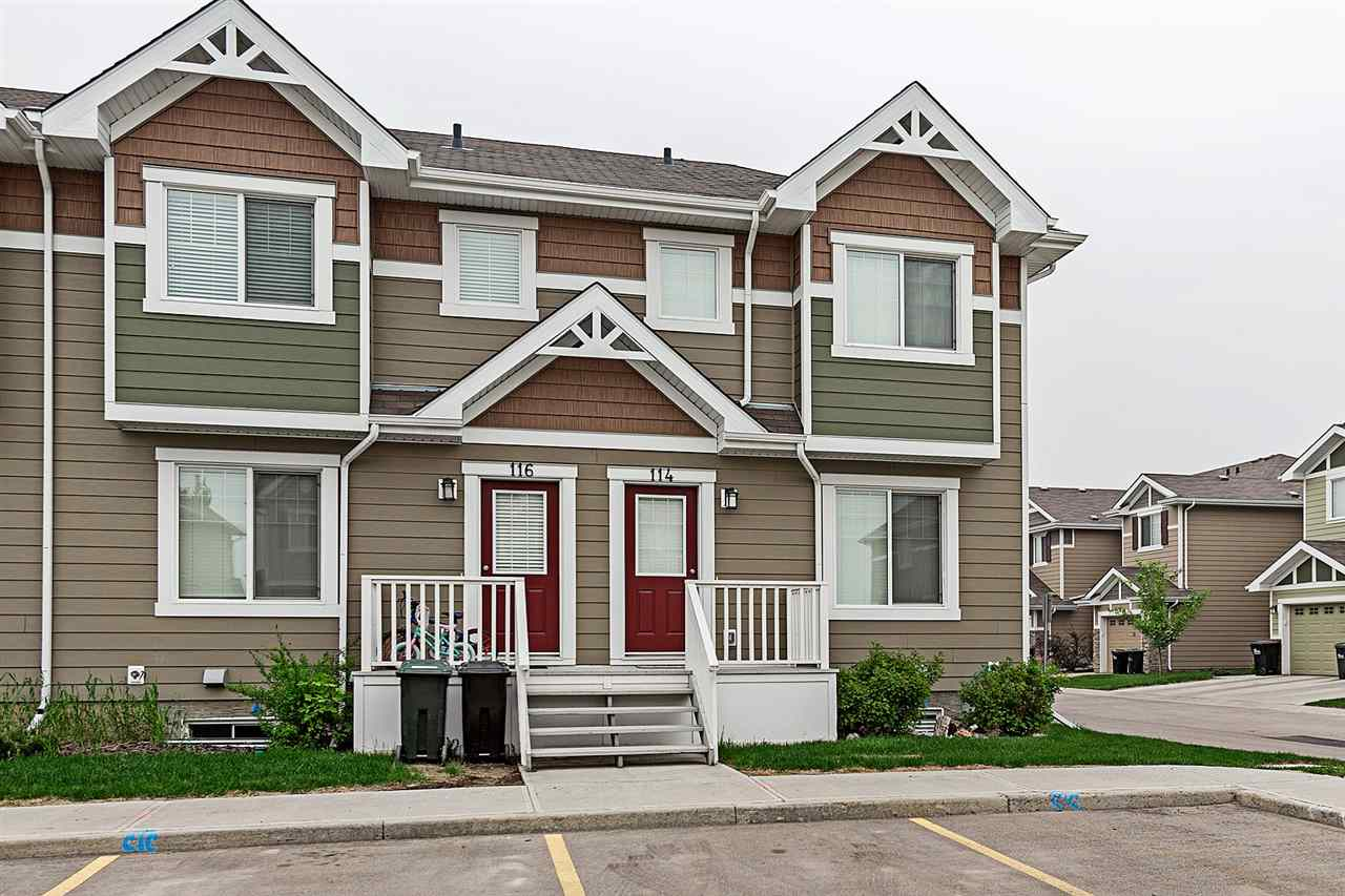 Don't let this opportunity pass you by to be a part of the Lakeland Ridge neighbourhood at a very affordable price! LOW Condo Fees! This is truly a best-case bang for buck opportunity. Loaded with upgrades, this 1,037 SqFt 2 Storey END UNIT townhouse has 3 Bedrooms, 2.5 Bathrooms & is so well cared for - it's like new (built in 2014). Very high-efficient with a tankless water heater; Triple Pane Windows; High-Efficient Furnace as well as high-end Hardie Board exterior. Many windows make the main floor very bright & dark hardwood flooring flows throughout the spacious living room into the kitchen featuring Stainless Steel appliances, plenty of cabinets & counterspace. A dining area leads out into the fully fenced backyard. It is so easy to imagine hosting your family & friends here! A 1/2 bath & laundry complete the main floor. The upper floor has 3 bedrooms incl. a large master c/w a full ensuite. The basement awaits your touch! Close to everything: schools, parks, public transportation - you name it!