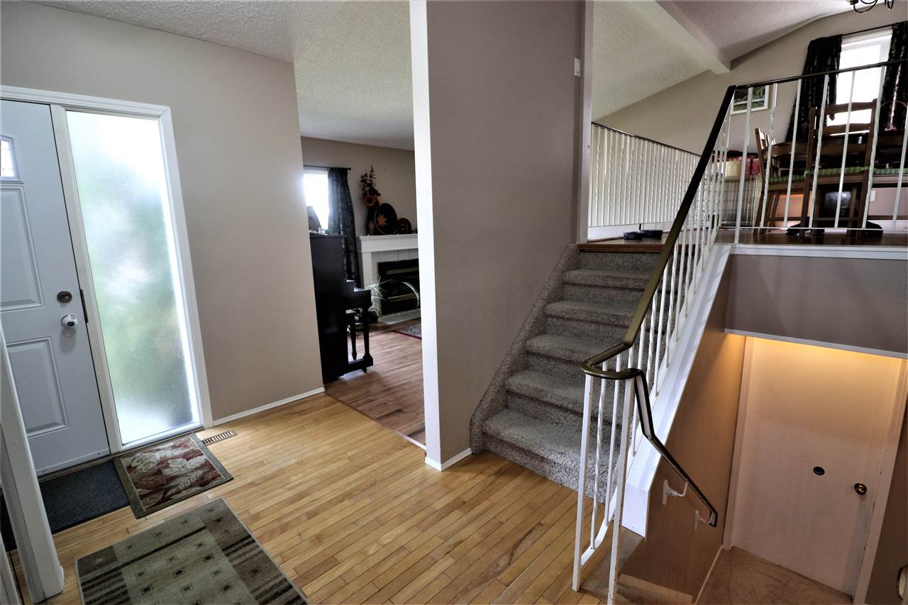Nice family home located walking distance to a school, convenience store & steps to the transit. This 3 level split has a spacious entry with hardwood flooring & newer front & side doors along with handy screen doors. The living room with laminate floors completes this level. Up one level is a dining area/flex room that over looks the living room. Off the dining area is an eat in kitchen. Completing this level is a large master bedroom, a second bedroom & full bath. The bathroom is upgraded with a soaker tub, modern vanity & marble tile floor. The entrance is also open to the family room on the lower level. French doors lead to an office. On this level you will find bedroom #3, a 3 pce. bath & laundry room. Thee are vinyl windows throughout. Enjoy a deck off the side entrance. There is a double concrete parking pad at the back. The yard is fenced.