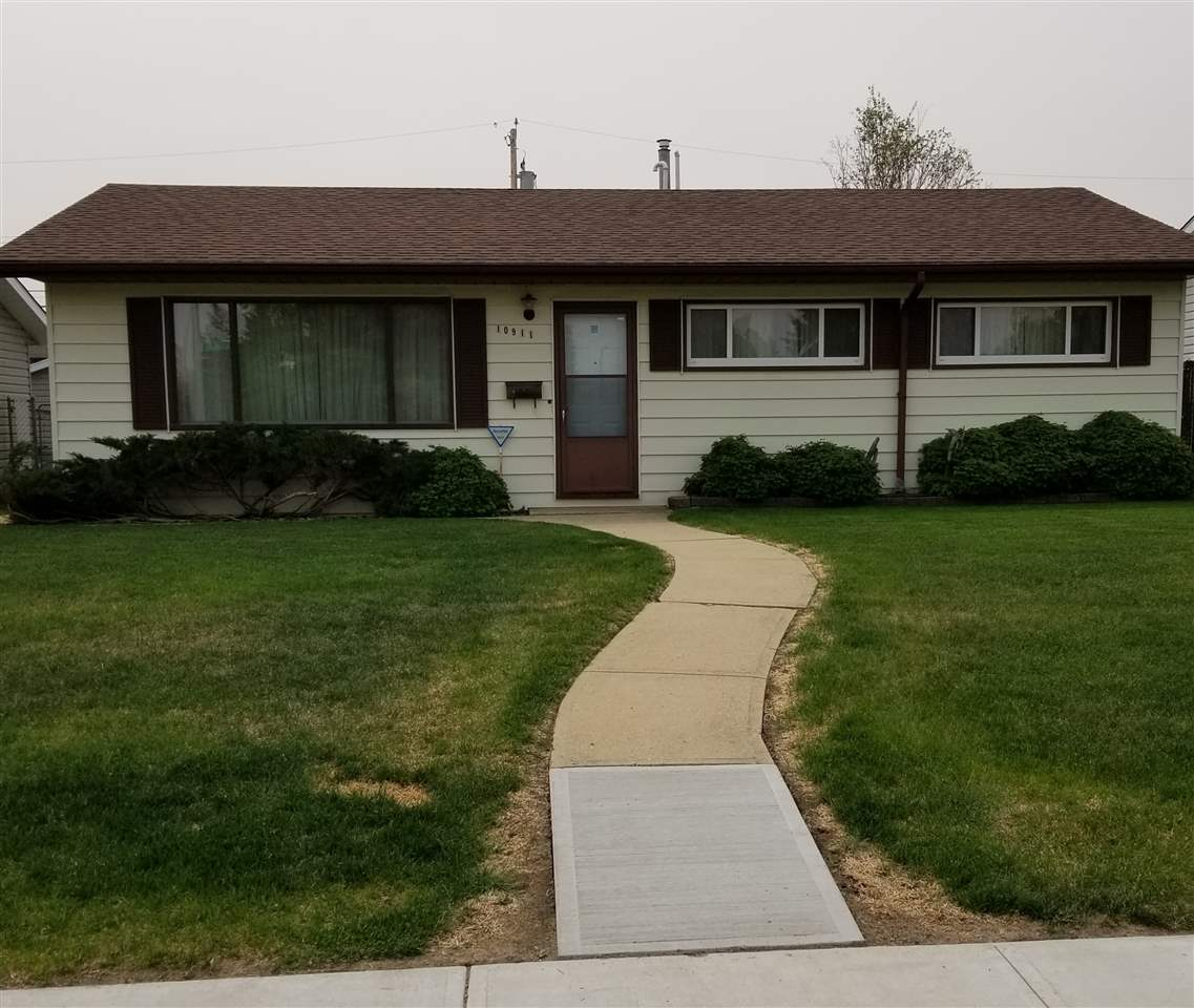 This well cared for 1073 SF home has been a one owner home since 1960. The property has been well loved and maintained over the years and is ready for a new family! Located on a quiet street in North Edmonton ,close to schools, shopping and parks. This home features ground level entry excellent for someone that cannot deal with steps. The home has 3 bedrooms, good size kitchen, dining room, large living room and 4 piece bath and 100 amp service. The home is located on a large lot with a double over-sized detached heated garage, a large dog run, ample space for RV parking, patio area and play space. Upgrades include shingles, furnace, Hot water tank, vinyl siding, windows and metal cladding, new city sidewalks, chain link fencing, security system,  This home is ready to move in or would be an excellent investment property.