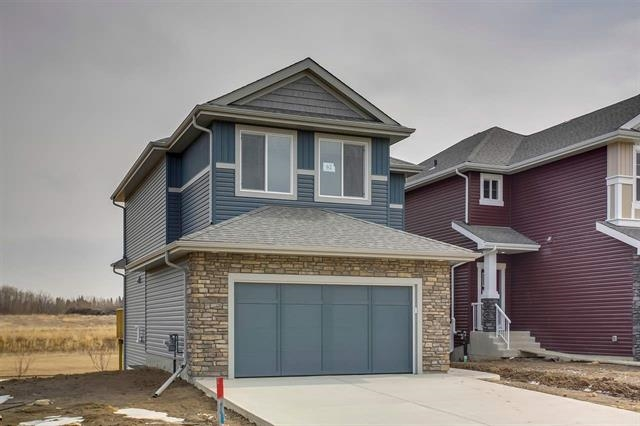 Presented by Mac & Mitch Homes, building homes for 70 years. This 2000 sqft 2-storey w/WALK-OUT BASEMENT is located in the great family area of Prescott. Loaded w/upgrades, this quality built home will surely impress anyone. The main floor offers an awesome floor plan w/loads of natural light, gorgeous hardwood floors, premium 2-toned cabinetry, quartz counters, living area w/tile surround linear fireplace, dining area, full laundry room, and very functional mudroom. The upper level is home to 3 total bedrooms, including the spacious master retreat w/HUGE walk-in closet and 3-pc ensuite. You will also find the large bonus room and additional 4-pc bath. Other features include: APPLIANCES INCLUDED, triple pane windows, HRV system, completed deck that OVERLOOKS GORGEOUS CREEK/PARK, and more! Located steps from the Prescott Learning Centre (K-9)/YMCA Wellness Centre, and minutes from the 60 acre Jubilee Park, and all other amenities. All of this for under $500k, you cannot beat this value!