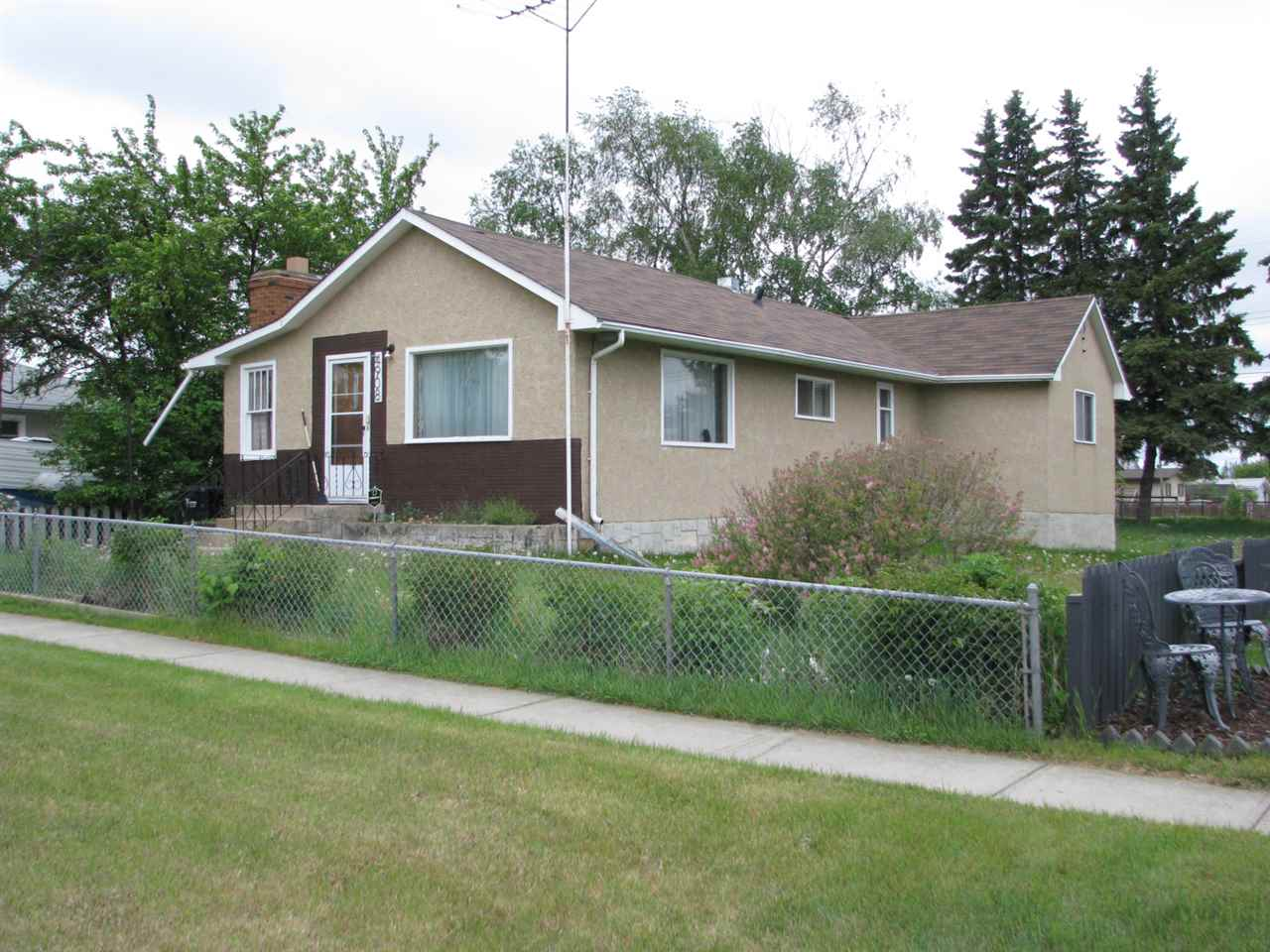 Larger Bungalow on a quiet tree lined street in Down Town Bruderheim. New Shingles New High Efficient Furnace and Hot Water Tank. 3 Bedrooms and a Den. Requires some TLC. Close to down town amenities.Good Neighborhood. LARGE Double Lot. PROPERTY SOLD AS IS.