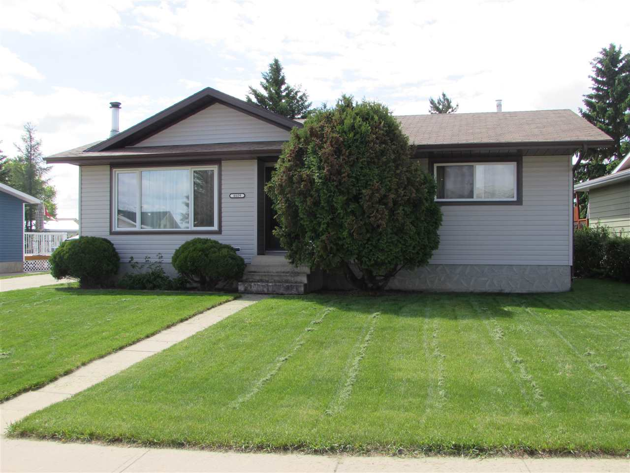 Extremely well taken care of bungalow with plenty of upgrades.  Backs onto park. Furnace in 2018, Hot water Tank in 2013, Shingles in 2010, Window in 2004 and 2017, siding in 2008, Kitchen renovation and much much more... 1150 sq.ft with double insulated detached garage.  Partly finished basement with fireplace, rec room and bedroom and potential bathroom.  This 1980 home has been well taken care of and price of ownership is apparent from the minute you walk in.