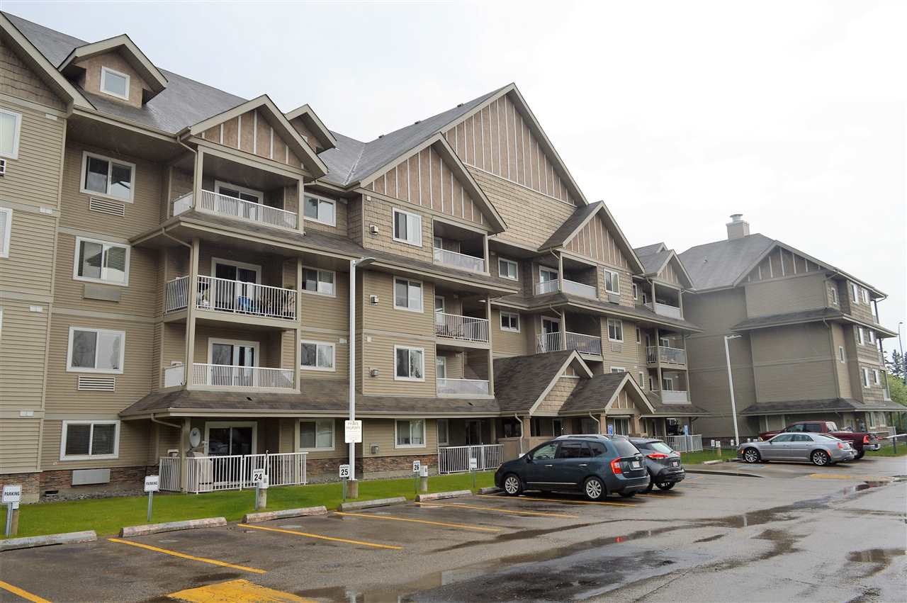 Welcome to The Palisades in Spruce Grove. The WHITE KITCHEN is spacious with tons of cabinet and counter space, an eating bar island and features one of the largest WALK-IN PANTRIES I have seen in a condo! The living room is flooded with natural light and features a corner GAS FIREPLACE. The master bedroom is large enough for a king bed and has walk through double closets leading to the 4 piece ENSUITE bathroom. A second bedroom, 3 piece main bathroom and large laundry room complete this great property. Also included is a titled, HEATED UNDERGROUND PARKING with an extra storage cage. The complex also has a car wash station and a separate clubhouse you can book. Located walking distance to the Tri-Leisure Centre. This is one not to be missed!