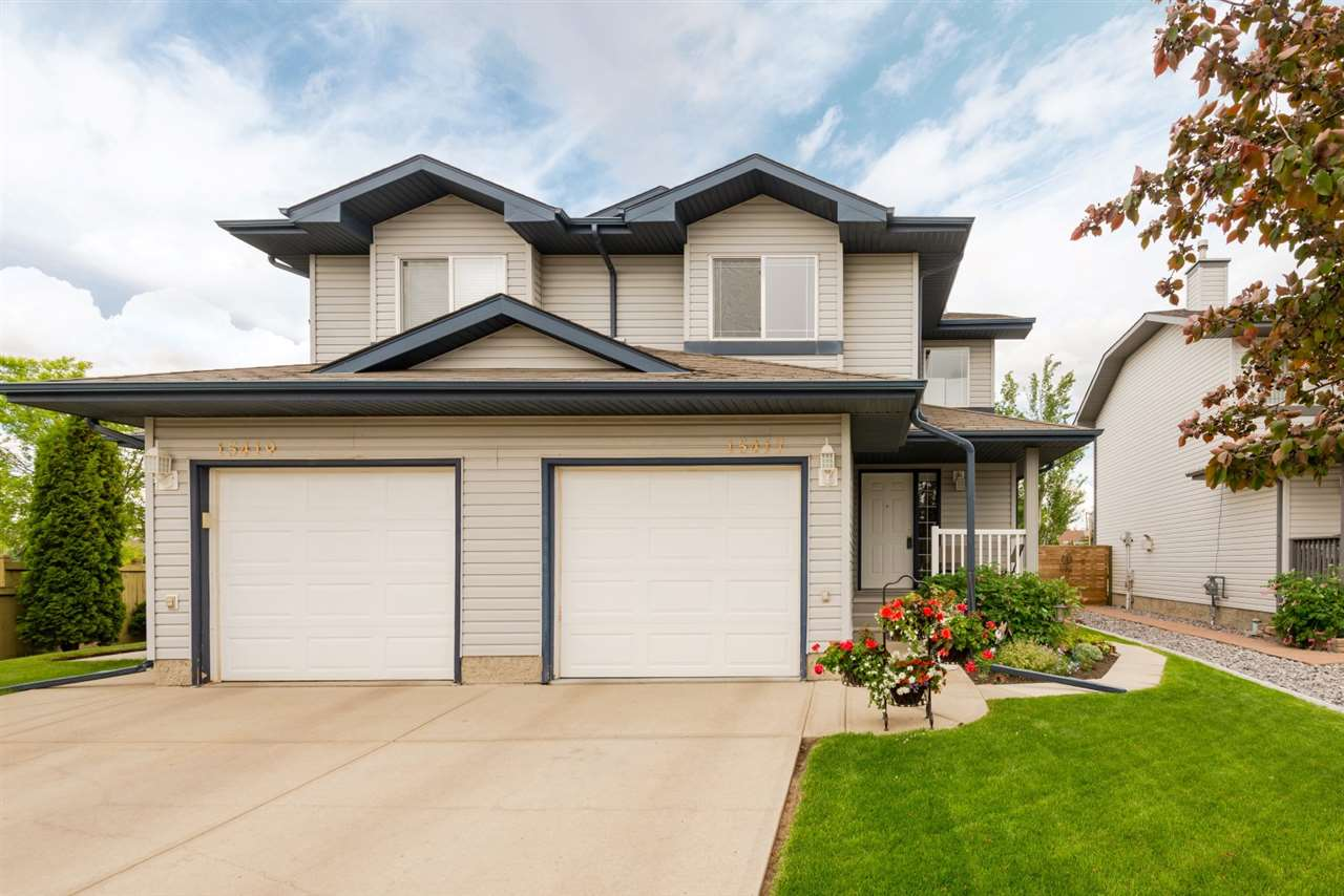 Wow all I could say, pride of ownership in this stunning Half-duplex located in the well sought after community of Carlton and with in a stones through to the lake and walking paths. Features 2 Master Bedrooms up with walk in closet in both and 2 4 piece en-suites as well. Main floor has a huge island kitchen with plenty of cupboard space, high end appliances which include a gas stove, beautiful hardwood flooring throughout, a living room with a cozy warm corner gas fireplace, a 2 piece powder room, a dining room with a patio door that leads to a Gazebo, maintenance free deck,  with a gorgeous landscaped, fenced in yard. What a great place to call home and is a real pleasure to show.