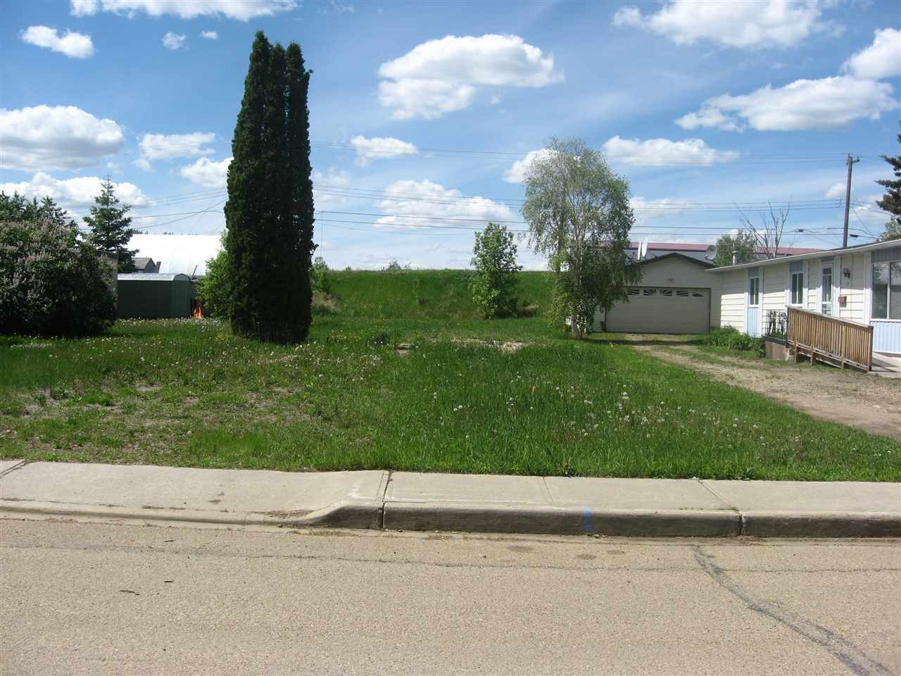 Fully serviced lot that is zoned for mobile homes or built a regular house on this well located lot with back alley and lots of room for a large garage.