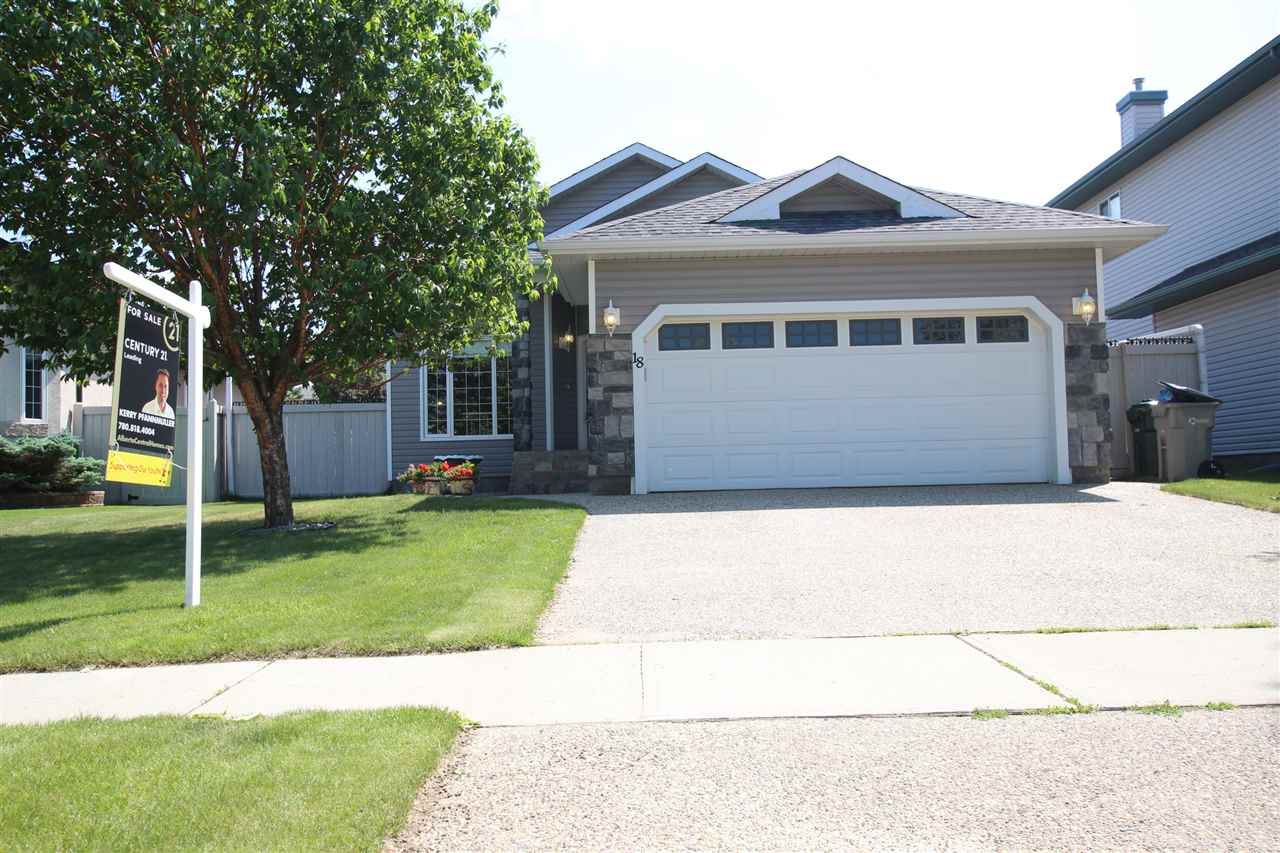 Welcome home to this bright and spacious 2 + 3  bedroom plus den Bungalow in the prestigious Willow Park in Stony Plain!   This home boasts an abundance of natural light with the huge windows and an open floor plan,   There is a 3 sided gas fireplace between the livingroom and dining area,   Large Chefs kitchen with a great island, and large corner pantry. Livingroom has a great built in decorative shelf to display art collections!  The front office space is bright and spacious and a great place to concentrate on your small home based business.  The Master oasis has his and her closets, and a beautiful ensuite with a deep jetted soaker tub and separate shower.   The hardwood flooring, paint, main floor laundry is all newer.   The Basement is fully finished with another great livingroom space with a 2nd natural Gas fireplace,  and 3 bedrooms,  2nd laundry area and a 3 pc bath.   South facing Back yard with sun deck is a great place to spend summer days!  Close to walking trails, shopping and schools.