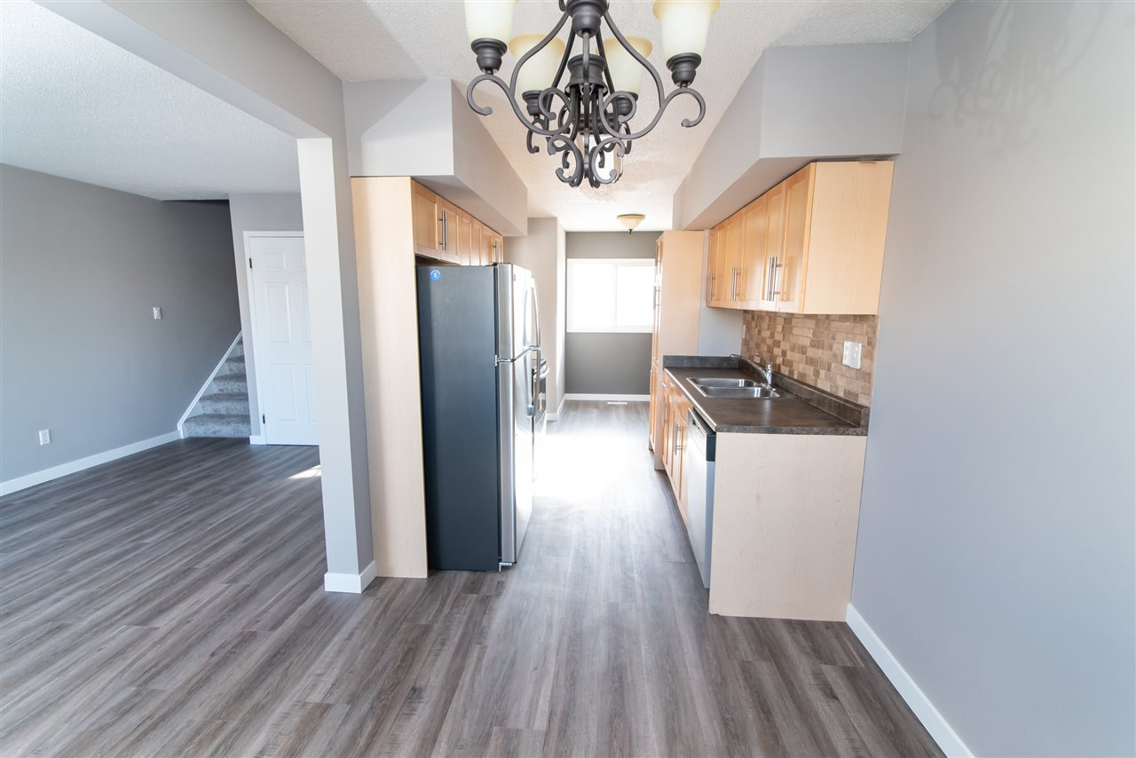 CHEAP CONDO FEES....EDMONTON BEST DEAL!!, SHINGLES/FENCES/WINDOWS/...TOTALLY RENOVATED?NEW LAMINATE VINYL PLANK FLOORING (WHAT EVERYONE WANTS NOWADAYS !)?.NEW APPLIANCES?BRAND NEW COUNTERTOPS. This 2-Storey, 3 Bedroom townhouse is FULLY RENOVATED from top to bottom! Stainless Steel appliances, upgraded light fixtures, new paint, new floors, new carpet?.It?s all here and it?s all new! This townhouse needs nothing! Kitchen was just a couple years back(wow) Walk into your new home and immediately notice the beautiful functional layout and warm feel! A great kitchen with new appliances makes cooking and entertaining easy! Your intimate dining nook is open to your living room and offers easy access to your back yard, adding convenience. Head upstairs to your 3 bedrooms and 4-pc bath! Unspoiled basement ready for you! ONE OF THE BEST MANAGED COMPLEX WITH THE BIG TICKET ITEMS ALL DONE...FENCE, ROOF, WINDOWS, SIDING... ITS ALL HERE! All this with low condo fees! Welcome home!