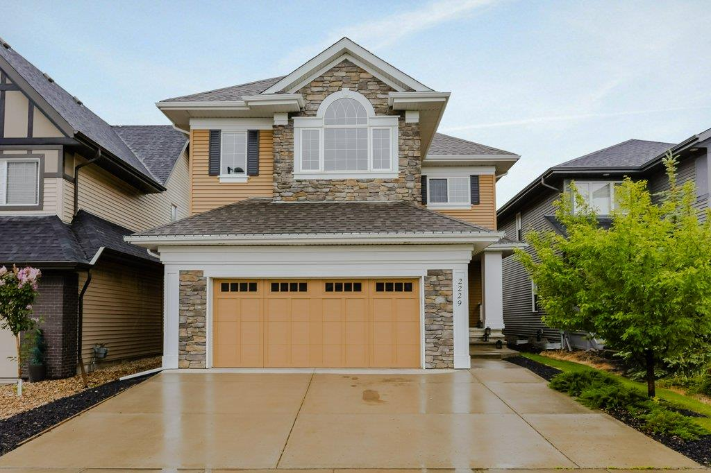 #imagineyourlife?Nestled in the prestigious community of Cameron Heights, close to parks, ravines, bike trails and easy access to the Anthony Henday. This MODERN STUNNER is 2515 sqft of luxury living space featuring 3 bdrms, 3 baths, and dbl garage. The open and bright main floor features a HUGE island perfect for entertaining, and boasts ULTRA modern finishes, including new wide plank hardwood floors, gorgeous lighting, stainless appliances, wall oven, pantry and tons of  sleek Euro style cabinets. The main also has a den, powder room and a spacious mud room off the garage with ample storage space. Follow the glass railed staircase up to find 3 bdrms including a spacious master suite with walk in closet, luxurious 5-pc ensuite featuring a corner soaker tub, double sinks and walk in glass shower, 2 more bdrms, full bath, a generous bonus room with big windows and large laundry room! The beautifully landscaped and private backyard features a deck and stone patio for entertaining and backs onto a bike trail