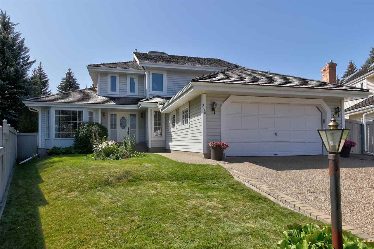 Location, location, location in prestigious OGILVIE RIDGE on 2ND BIGGEST PIE LOT in neighbourhood, siding & backing walking trails to parks in either direction. This 2303 sq ft, R2000, air conditioned 2-storey has an impressive huge foyer, main floor living room & sunken family room w/FP, den/bdrm, laundry, formal dining area, island kitchen & breakfast nook. The upper level has 3 bedrooms including an elegant master bedroom with French doors, hardwood, WI closet, 5 pce ensuite with jetted tub, skylight & WI shower.  The basement is developed with the 2nd family rm, flex rm, cold rm & 4 piece bathroom. Upgrades include:  new cedar roof & eavetroughs (2013), furnace (2016), Trex deck (2015) water tank (2011), front & back doors (2016), some flooring (2011), fence (2012-2016), & some new toilets (2018).  There is also an oversized dble attached garage, exposed aggregate driveway & sidewalks, all in a quite cul de sac & was built by Carriage Custom Homes with a gorgeous private yard.  Truly a Must to See.