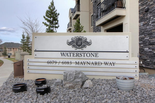 Exceptional main floor 2 bed, 2 bath unit in Magraths Waterstone complex. Located with direct views of the man made pond and walking paths, there is truly no better view than from your south facing patio. This spacious 2 bedroom unit offers an open floor plan design with generous and well laid out kitchen which is open to your formal dining area and living room. All makes for great entertaining. Two generous bedrooms with their own full bathrooms, insuite laundry and storage round out this nice package. Oh! and let's not forget. This all comes with two individual titled underground parking stalls (not tandem) with storage cage. There simply is no better value to be found.