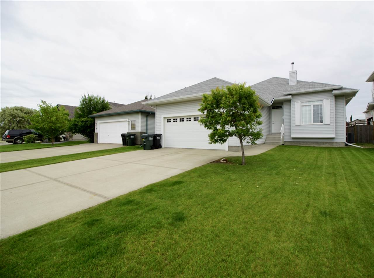 This beautiful air-conditioned home is located in the family friendly orientated neighbourhood of Clarkdale Meadows and close to public transportation, new school, walking trails, parks, shopping etc is the meticulously maintained 1350 sq ft bungalow.Step inside the foyer and immediately find the den/flex/bedroom on the right. Down the short hallway is the open floor plan with spacious kitchen that has an abundance of cupboard and counter space including a corner pantry.The adjoining dining area leads you out to your deck with gas line for BBQ and large yard that features artificial turf.The shed and swingset to stay!The large bright living room has a gas fireplace.Down the hallway is the entry to the garage with laundry, master bedroom with 3 pc ensuite, and 2nd good size bedroom.The basement is 90 percent finished with 9ft ceilings & includes a rec room, bedroom, bathroom with shower, loads of storage.Double attached garage with a floor drain completes this wonderful family home.