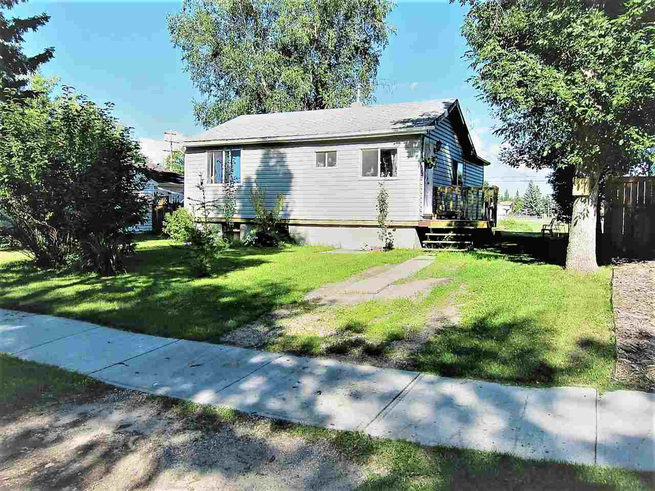 This nicely upgraded home is located on a quiet street close to schools, shopping and all amenities. Substantially renovated approx 4 yrs ago the upgrades include: new kitchen cabinets, countertops, windows, electrical, plumbing, doors and more. It has 2 bedrooms up and 1 in the basement. Other past upgrades are the furnace and shingles. The property backs onto a school playground and the lot is 55 ft x 140 ft which gives you all the space you need. There yard is fenced and there is a good size storage shed in the back. There is also back alley access. Great starter or investment home.