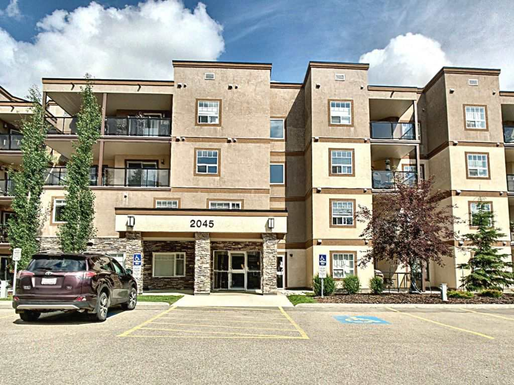 Welcome to the great Granville neighborhood and this fantastic Apartment. Located on the first floor of building , this Apartment is extremely quiet and has a great view of the front courtyard. The layout makes the apartment feel a lot larger than it appears. With the bedrooms on either side including their own bathrooms, creates an open feel between them for the seperate kitchen table area, large open galley kitchen linking both sides, and the living space in front of a serene electric fireplace. You will feel comfortable and home upon arrival and the easy use of all closet space, laundry room, cupboards and more helps you move in with ease. Apartment Includes: Heated Underground Parking 1 Stall and enclosed Storage Area. Building Amenities: Gym, Heated Car Wash Bay, Lounge with pool tables with Full Kitchen, and Guest Suite.