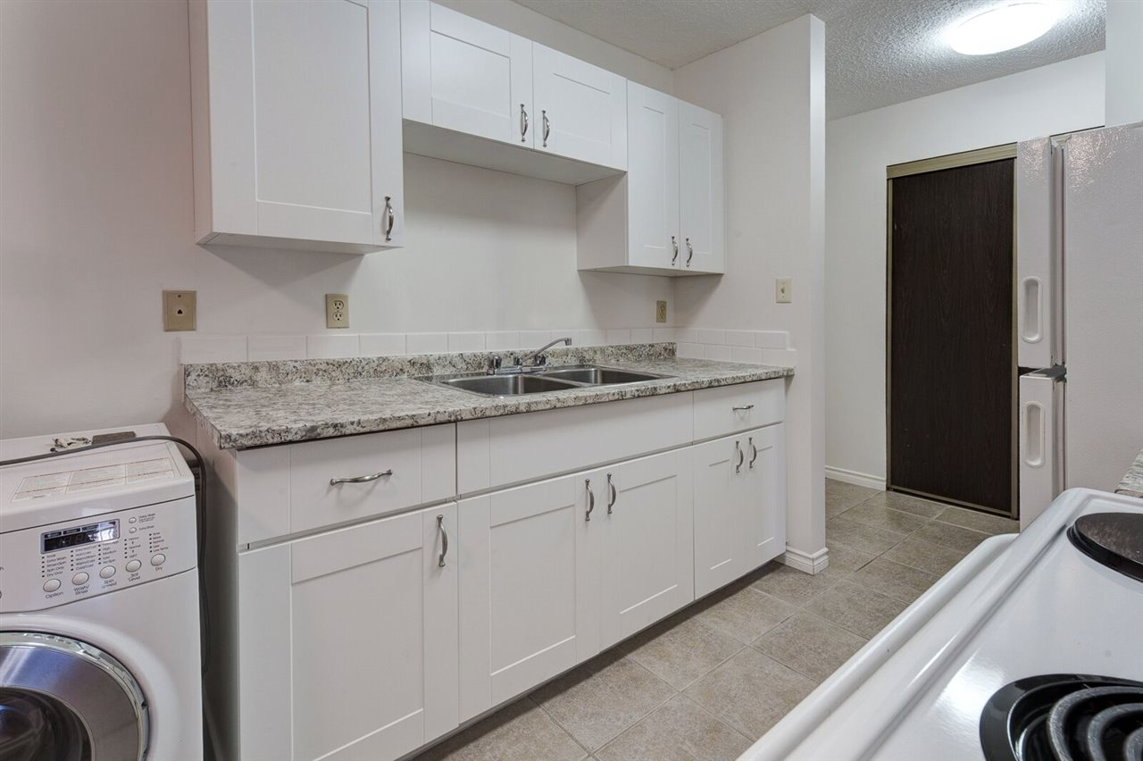 Start building your equity!  Cute and cozy one bedroom, one bathroom condo in family friendly community of Keheewin Yellowbird.  NEWLY RENOVATED kitchen with timeless white cabinetry.  Bathroom was updated not too long ago.  Laminate and tile flooring throughout the unit.  Large balcony off the spacious living room.  Convenient insuite laundry.  There is also common laundry room on every floor.  Fabulous location right across from park and elementary school.  Public transportation outside the complex door.  Few block walk to Century Park LRT station.  Quick access to all amenities in South Edmonton Common and QE2 highway and international airport.