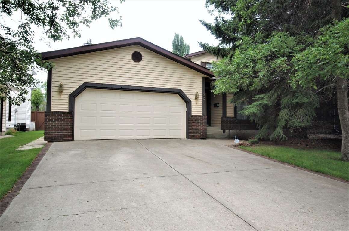 Lots of upgrades are found in this well maintained four bedroom home in Henderson Estates. New kitchen cabinets with a pantry, sinks, flooring and an island. Large breakfast nook with a wet bar, cabinets, computer desk and garden door to the deck. The main floor family room has a wood burning fireplace with built in wall unit. Main floor laundry, two piece washroom and direct access from the garage into the house. There is a large formal dining room and spacious living room. Four good size bedrooms upstairs. The master ensuite has two sinks, a jetted tub and the walk-in closet has built-in organizers. All bathrooms have newer sinks and vanities. Two furnaces, two air conditioners and newer shingles. This is a fabulous location, close to schools, parks, shopping and public transportation. A must see!