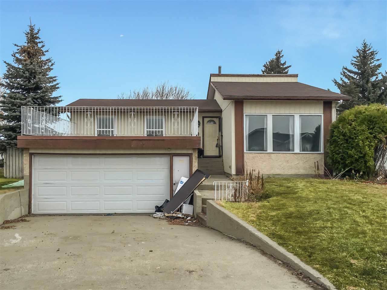 Fantastic 5 bedroom 1453 sq foot bungalow. West facing roof top patio located on the double front attached garage with a 8000 sq foot YARD in Cul De Sac. This is a HANDY Man Special requires some work, including finishing the basement bathroom, baseboards, panting, landscaping, cabinets and appliances in a great family neighborhood close to the River Valley in the NE quadrant of Edmonton. Recent upgrades include, shingles, hot water tank and furnace.