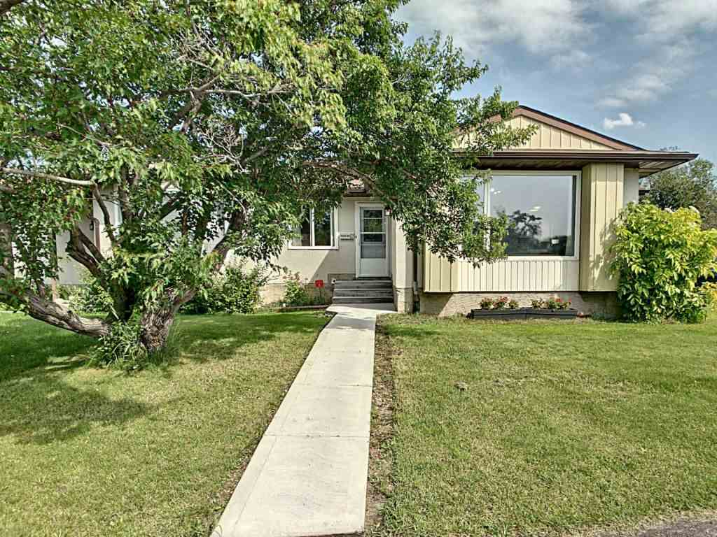 Beautifully updated 1/2 duplex BUNGALOW with 3 bedrooms, 2 full bathrooms (1 with a jetted tub), duplex bungalow with a deck and fenced backyard (& large storage shed). Lots of windows make it bright and airy plus the open concept layout make it perfect for your family. You have 2 private reserved parking stalls plus lots of rooms for visitors to park. Located on a quiet street but close to schools, playground, and shopping with quick access to The Henday or easy access downtown. This is a must see!