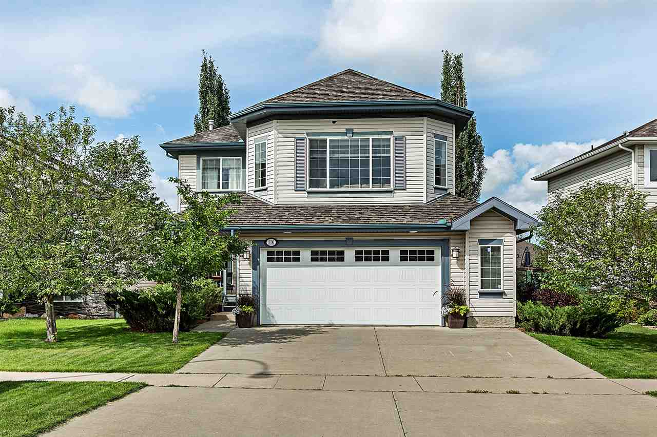 Be a part of Lakeland Ridge with this former showhome! This 2,142 SqFt 2 Storey stunner has been meticulously cared for & is waiting for you & your family to call it your own. 4 total Bedrooms; 3.5 Bathrooms; Fully Finished Basement & oversized garage. Not to mention a beautifully landscaped, fully treed yard to take in the sun & enjoy privacy with minimal neighbours. The bright & open main floor features rich hardwood & new vinyl tile. This kitchen has plenty of counterspace, cabinets, a large island, pantry & new S/S appliances (within 1-4 y/o) - a great way to entertain your family & friends! The dining area & the spacious living room is separated by a 3-sided fireplace. A den, 1/2 bath round out this floor. The upper floor showcases a massive bonus room; full bathroom & 3 bedrooms that incl. a large master bedroom & its full ensuite. The basement's family rm; bedrm; flex rm; storage & bathrm are great for a large family (option for 5th bedrm). A/C; New W/D; in-house speakers; New garage door. WOW!