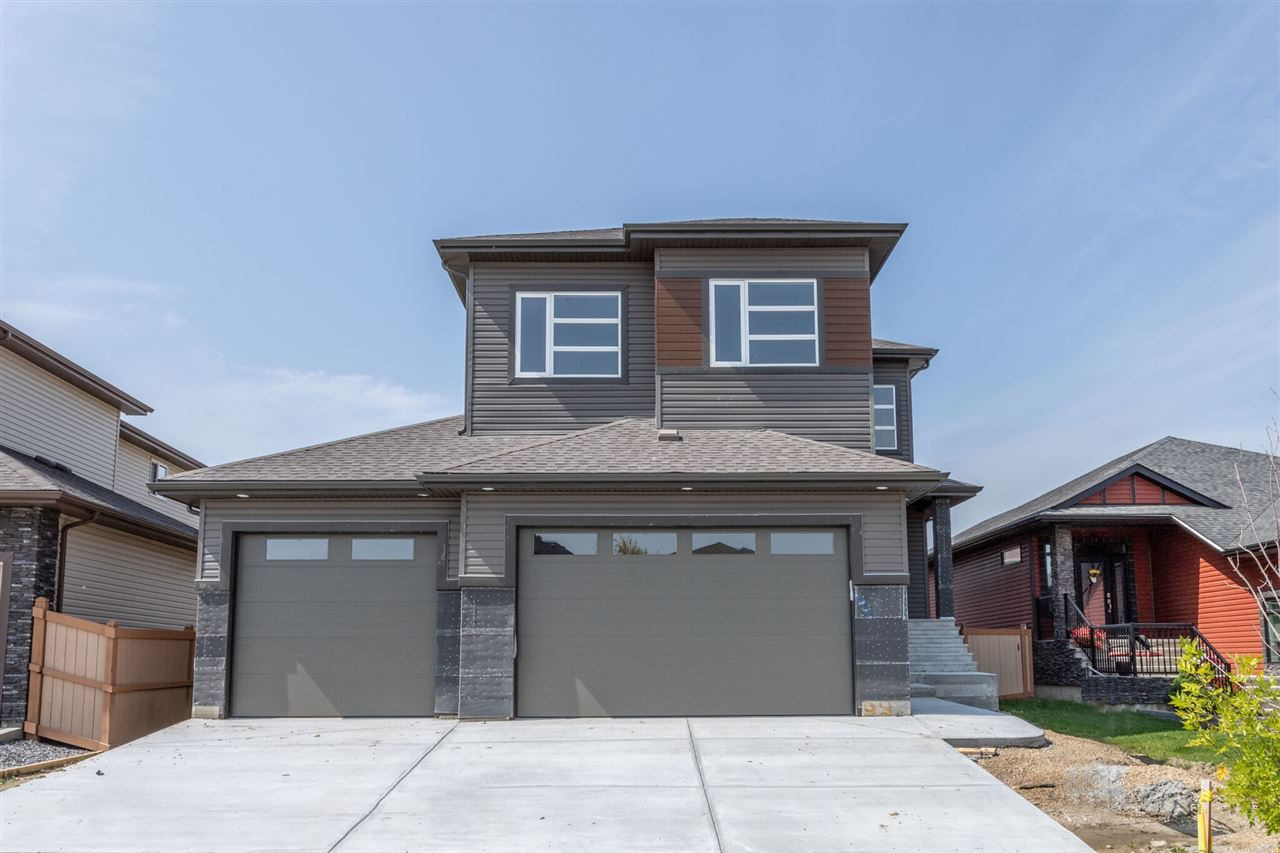 Brand new home in the premiere neighbourhood of Windrose. Beautiful home featuring 19 ft vaulting ceiling on main level & 9 ft high ceilings upstairs. Spacious entry way includes upgraded tile. Main floor has a spacious den, full 3 piece bathroom with oversized shower, large walk through pantry, living room with gorgeous fireplace with tile surround up to the ceiling,plus an upgraded kitchen with custom white cabinets. Stainless steel appliances are included. Hardwood floors on main level and quartz throughout. Oversized heated TRIPLE car garage with oversized doors. Upstairs has 4 bedrooms including the master bedroom that has lovely double doors that are 8 ft high (all doors on upper level are 8 ft), master en-suite features a double Jacuzzi and a 60x42 rain-head shower, separate water closet & walk in closet. All bedrooms have closet organizers. The bonus room has another beautiful fireplace. Upper level bathroom also include another oversized shower with seat. Too many upgrades to list
