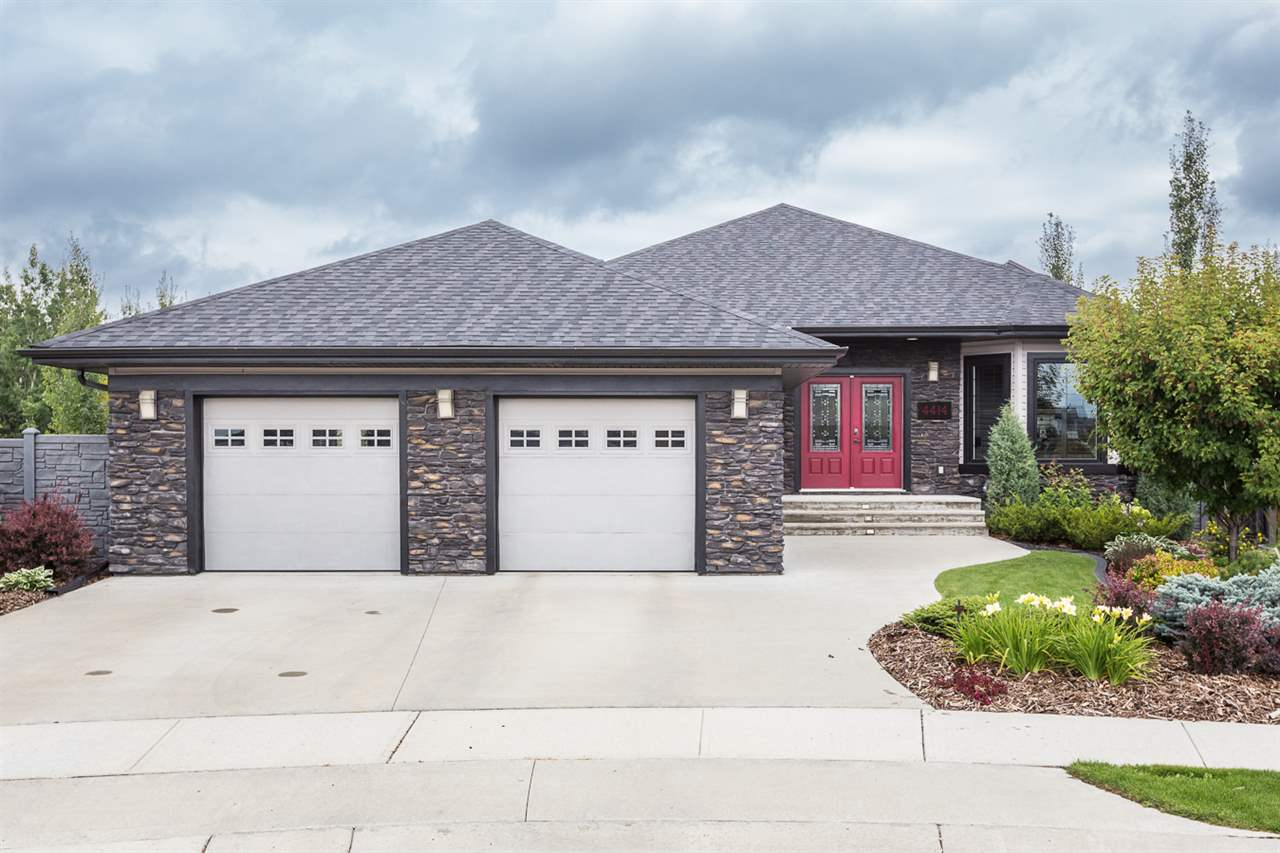 88k PRICE DROP! Outstanding walk out bungalow nestled in a quiet cul-de sac built by Ashton homes. Situated on a huge 9700 SF Pie lot backing onto trees for ultimate privacy! The moment you enter you will notice the soaring high ceilings & large windows giving it a bright airy feel. Main floor boasts an open concept plan, beautiful kitchen, large living & dining areas, office & laundry space w/ large master bedroom & ensuite. Basement features 2 bedrooms, full bath w/ Sauna, family room w/ home theater setup & huge area for a pool table with wet bar and an AMAZING enclosed deck that essentially is an extension of the home! Upgrades include high end hardwood and tiles throughout, granite counters, speaker system, A/C, central vac, custom shelves in closets, 3 gas fireplaces; heated floors throughout all tiled areas & tankless water system. The garage has heated floors, hot + cold water & drain. The yard is an oasis tastefully landscaped & features a gazebo, pond, covered deck, firepit & vinyl fencing.