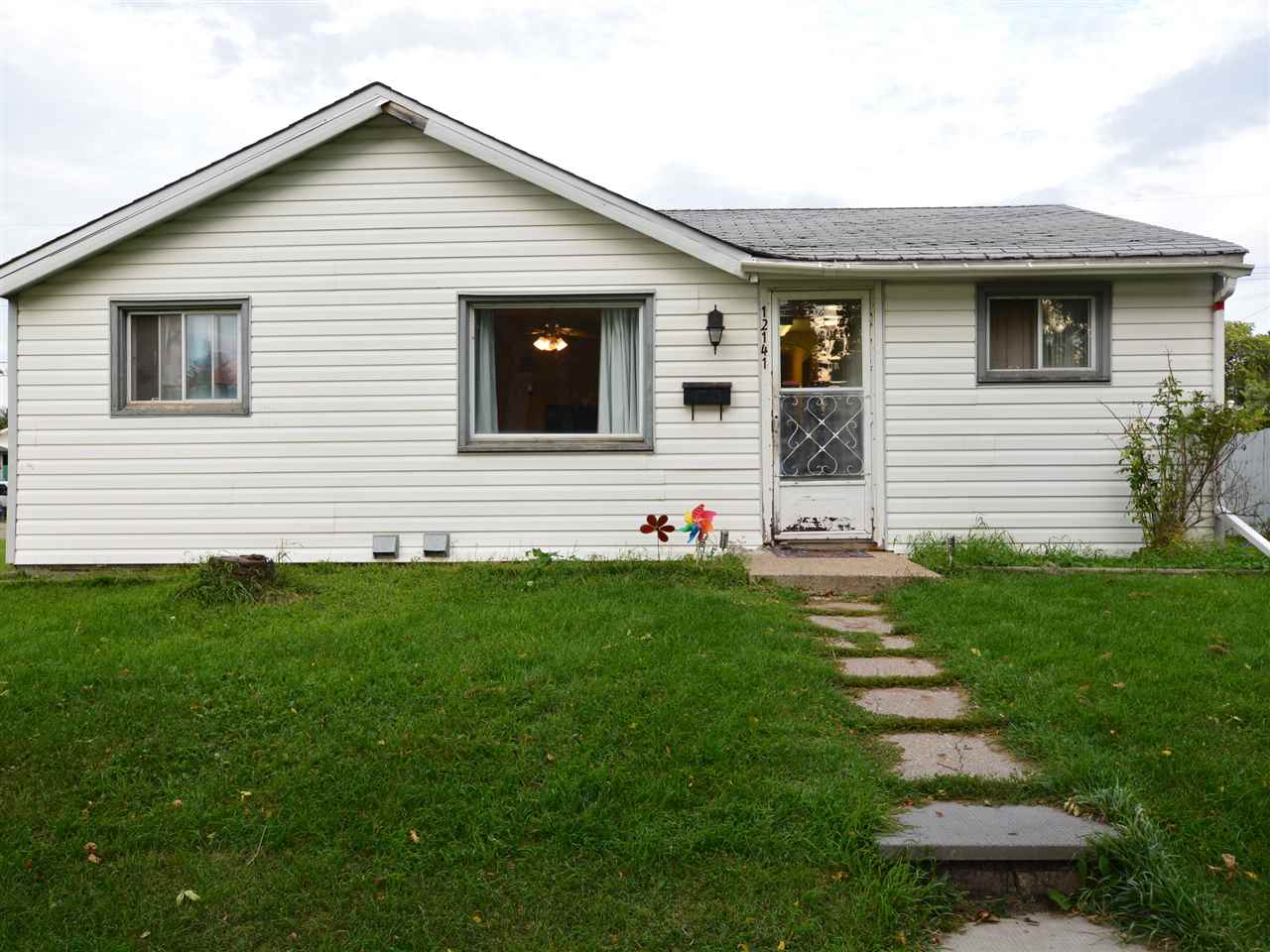 Older 908 sq ft basementless bungalow on 50' x 124.43' corner lot with an older single garage. House is still livable but requires cosmetic work. The current owners have lived here for 18 years. The property is in the process of being subdivided into two 25' x 124.43' lots which will be offered for sale at $99,900 each. Also option of a duplex or possibly a fourplex on this lot subject of course to final City approval.