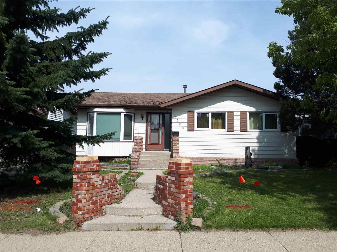 Welcome to this 1149SqFt bungalow with 3+1 bedrooms in the mature neighbourhood of Crawford Plains. This home features many upgrades including triple pane windows, upgraded attic insulation, newer high e furnace, newer kitchen countertops, hardwood floors, ceramic tile floors in kitchen & bath & newer garage doors. The main floor has a large living room with hardwood floors & bay window, large kitchen & dinette with lots of cupboard space & opens to the backyard deck. The master bedroom is complete with his & hers closets. The spacious main floor also boasts 2 additional bedrooms & 4 piece walk-thru bath with Jacuzzi tub. The basement has a bedroom with his & hers closets, family room, 3 piece bathroom, laundry room & a hobby room. The fully fenced backyard has a huge raised deck & an oversized (19.88 x 35.95) insulated car enthusiasts dream garage with 220 volt wiring, workshop area & back alley access.  Complete with a parking pad for an RV this house is just waiting for your family to call home!