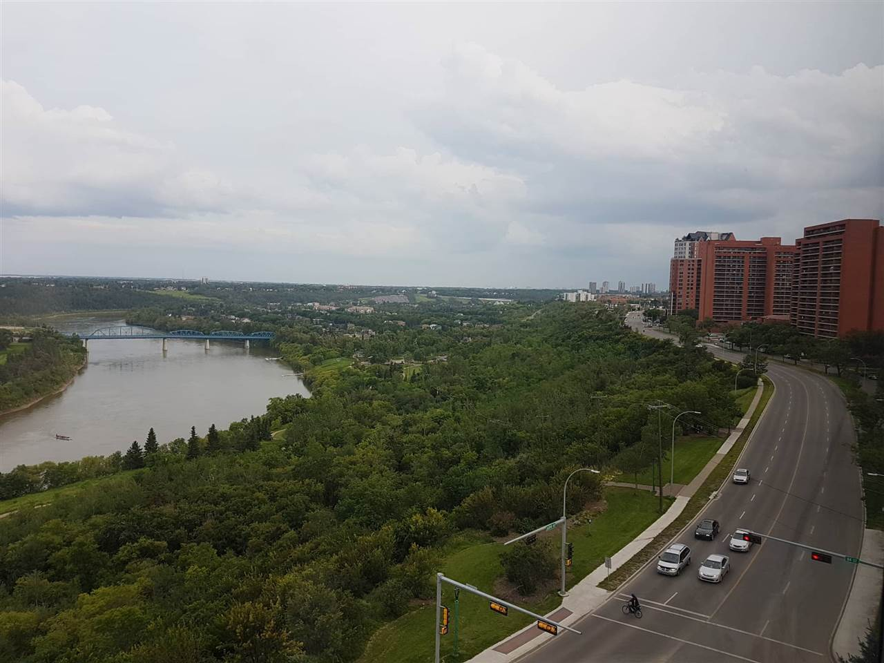 BEAUTIFUL CONDO!  GORGEOUS RIVER VALLEY VIEW , 11th floor concrete building condo on Jasper Avenue! This spacious 1 bedroom, 1 bath home is steps away from the river valley trails, Commonwealth L.R.T. and just minutes to the downtown core & new Ice District. AIR-CONDITIONED building which includes ALL UTILITIES AND CABLE. CENTRAL VACUUM, IN-SUITE LAUNDRY AND STORAGE ROOM. Other amenities include FITNESS CENTER, PARTY ROOM,BBQ DECK AREA, and SUN ROOM LIBRARY READING ROOM . This unit comes with 1 TITLED UNDERGROUND HEATED PARKING STALL# 132 and 2 visitor parking passes.  Comes with all appliances, Fridge,Stove,Dishwasher,Microwave and Window coverings. GREAT QUIET AND SECURED LIVING.