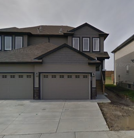 Half duplex in Tribute community in Leduc. This home offers 2 master bedrooms with an en suite & walk in closet each. Hardwood & ceramic flooring, gas fireplace in main floor living room, walk through pantry in kitchen, upstairs laundry, double attached garage & fenced backyard. This home needs carpet on stairs and landing upstairs.